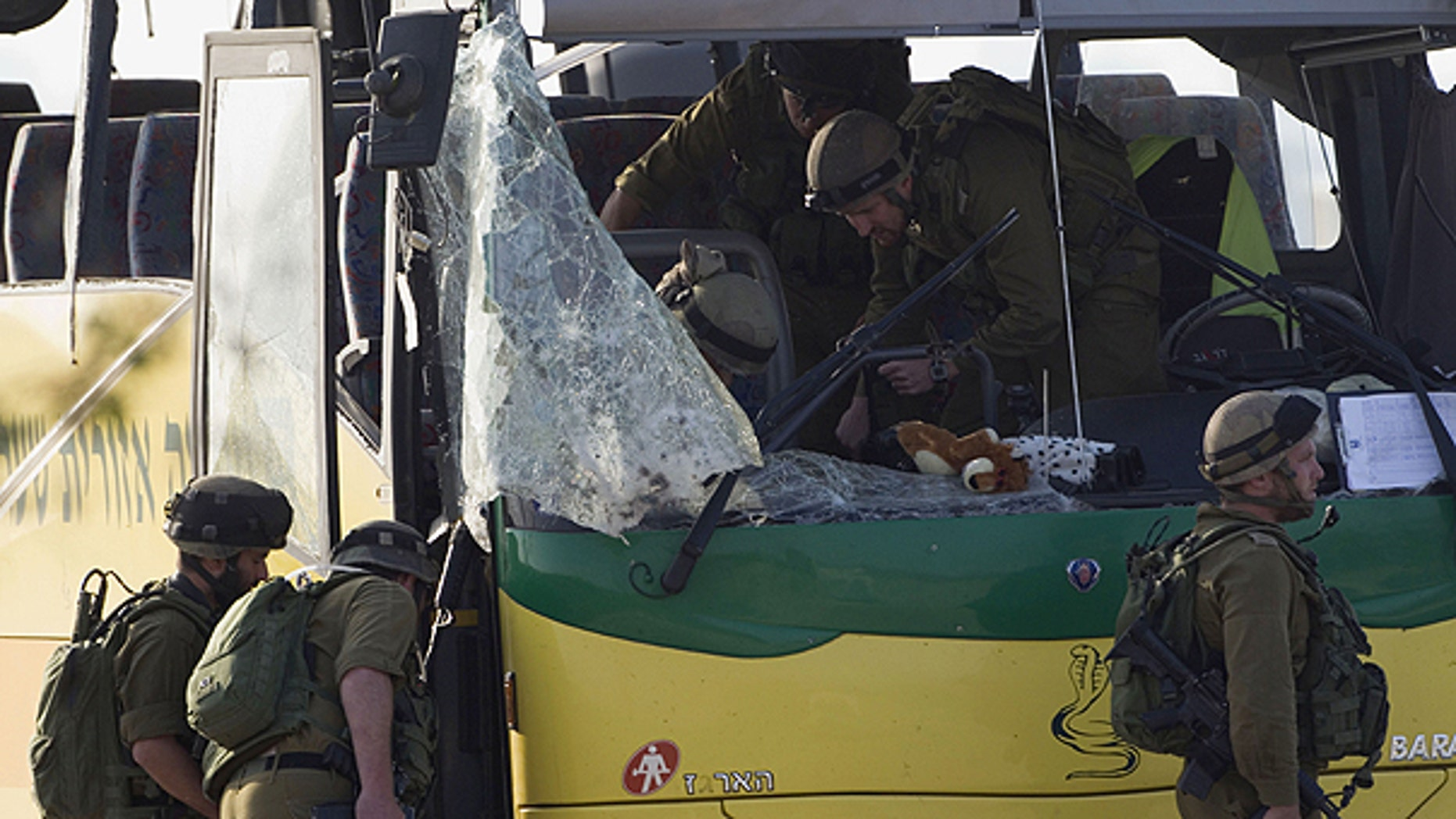 April 7: Israeli soldiers inspect a school bus hit by an anti-tank missile fired from the Gaza Strip near the border between southern Israel and Gaza at Sa'ad, Israel.