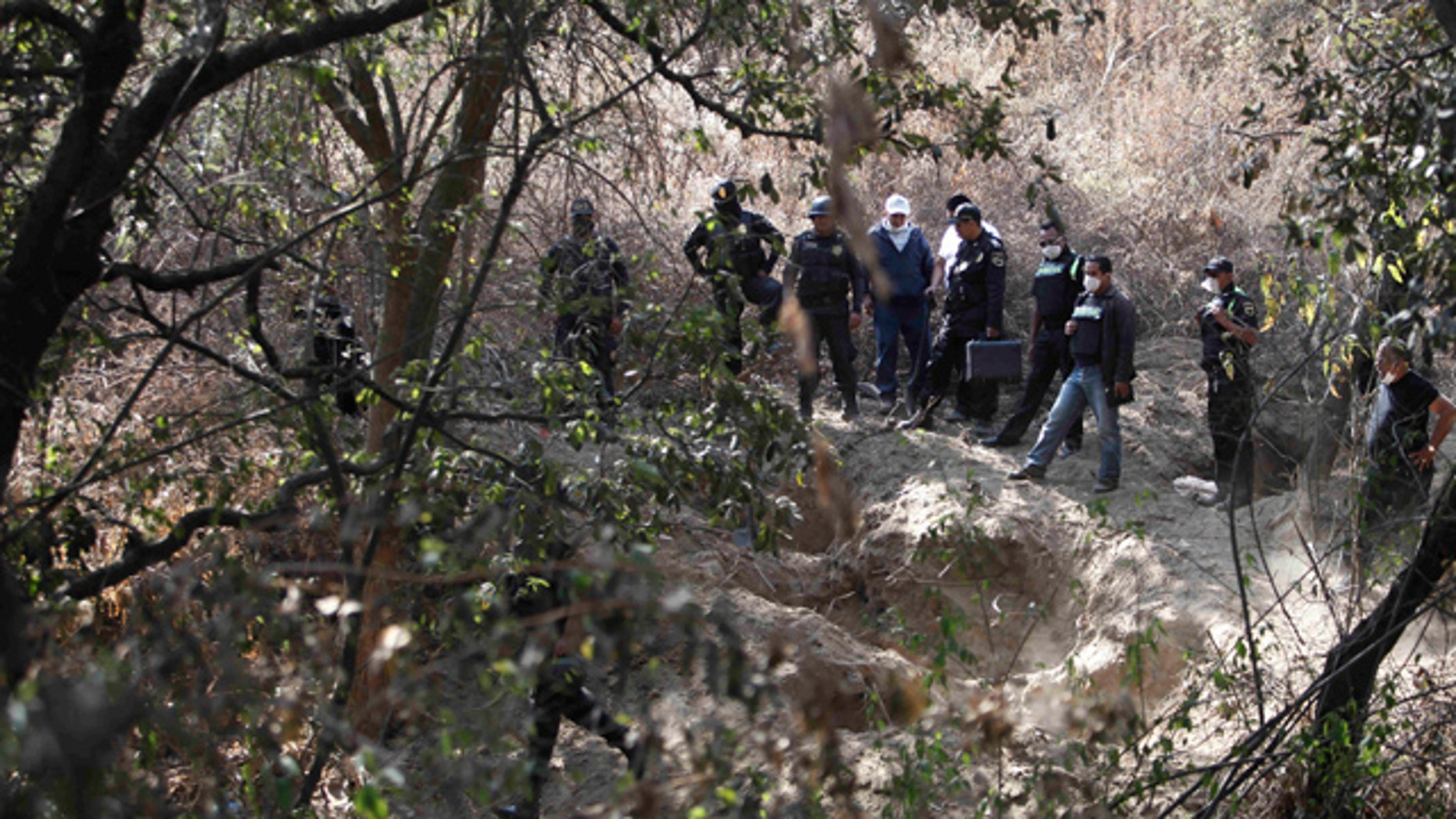 Feb. 27: State police guard the site where at least five bodies were found in a clandestine grave in Santa Mara Tlalmanalco on the outskirts of Mexico City.