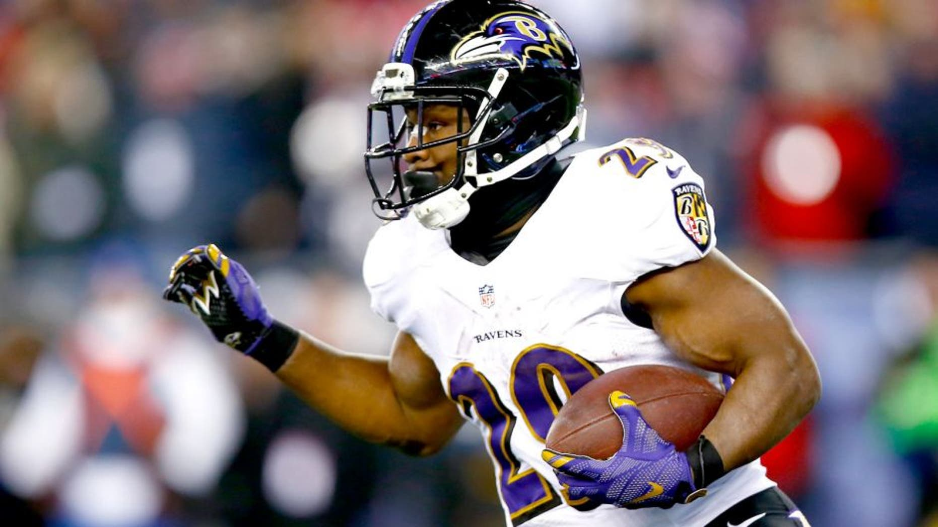 FOXBORO, MA - JANUARY 10: Justin Forsett #29 of the Baltimore Ravens carries the ball during the second half of the 2015 AFC Divisional Playoffs game against the New England Patriots at Gillette Stadium on January 10, 2015 in Foxboro, Massachusetts. (Photo by Jared Wickerham/Getty Images)