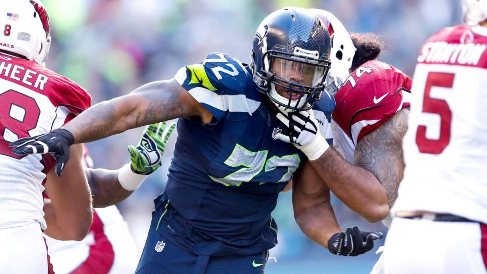 Nov 23, 2014; Seattle, WA, USA; Seattle Seahawks defensive end Michael Bennett (72) rushes the passer against the Arizona Cardinals during the second quarter at CenturyLink Field. Mandatory Credit: Joe Nicholson-USA TODAY Sports