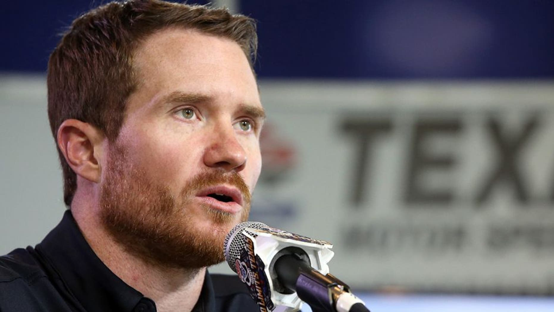 FORT WORTH, TEXAS - APRIL 07: NASCAR Sprint Cup Series driver Brian Vickers speaks during a press conference as Stewart-Haas Racing unveils the No. 14 TaxAct Military Files Free Chevrolet that Vickers will race in the Duck Commander 500 on Saturday night at Texas Motor Speedway on April 7, 2016 in Fort Worth, Texas. (Photo by Sean Gardner/Stewart-Haas Racing via Getty Images)