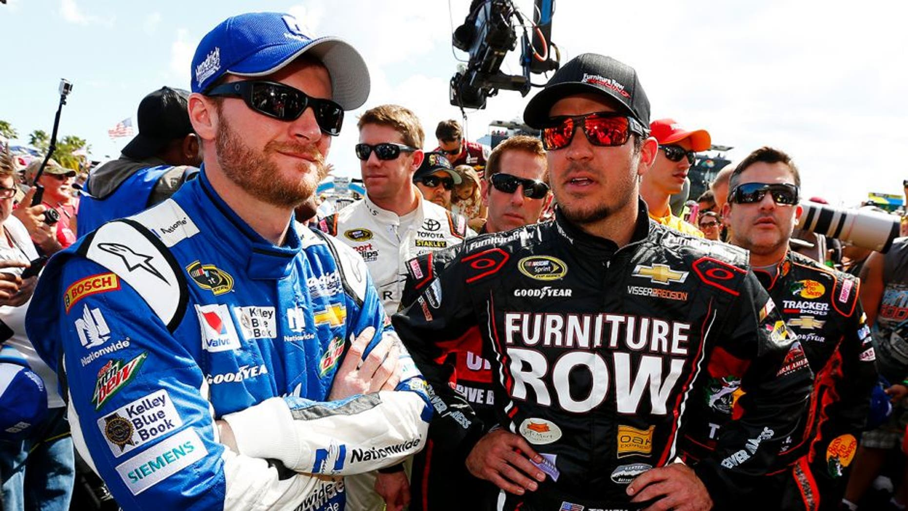 DAYTONA BEACH, FL - FEBRUARY 22: Dale Earnhardt Jr., driver of the #88 Nationwide Chevrolet, left, and Martin Truex Jr., driver of the #78 Furniture Row/Visser Percision Chevrolet, take part in pre-race ceremonies for the NASCAR Sprint Cup Series 57th Annual Daytona 500 at Daytona International Speedway on February 22, 2015 in Daytona Beach, Florida. (Photo by Jonathan Ferrey/NASCAR via Getty Images)
