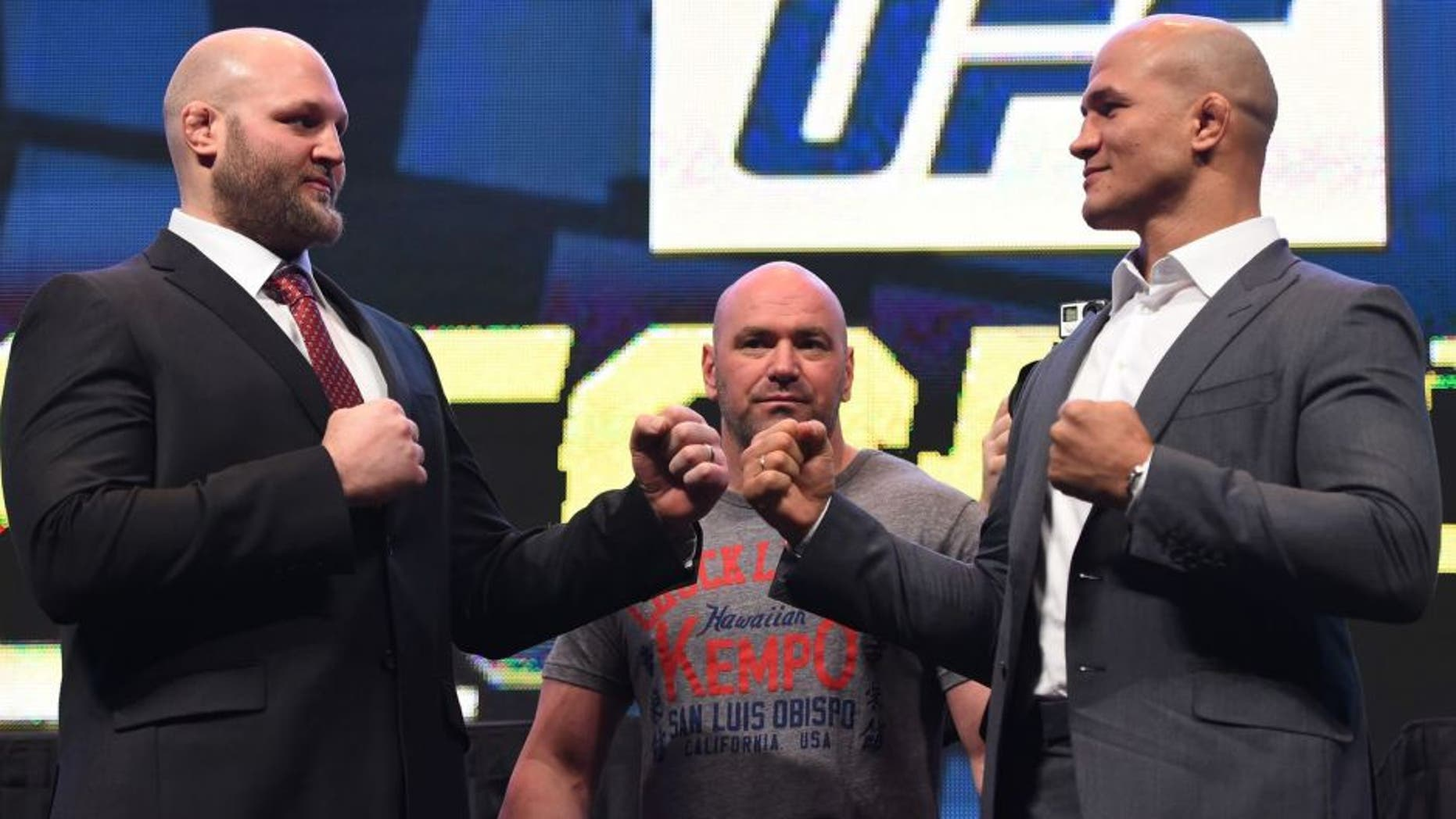 LAS VEGAS, NV - MARCH 04: (L-R) Opponents Ben Rothwell and Junior dos Santos face off during the UFC Unstoppable launch press conference at the MGM Grand Garden Arena on March 4, 2016 in Las Vegas, Nevada. (Photo by Josh Hedges/Zuffa LLC/Zuffa LLC via Getty Images)