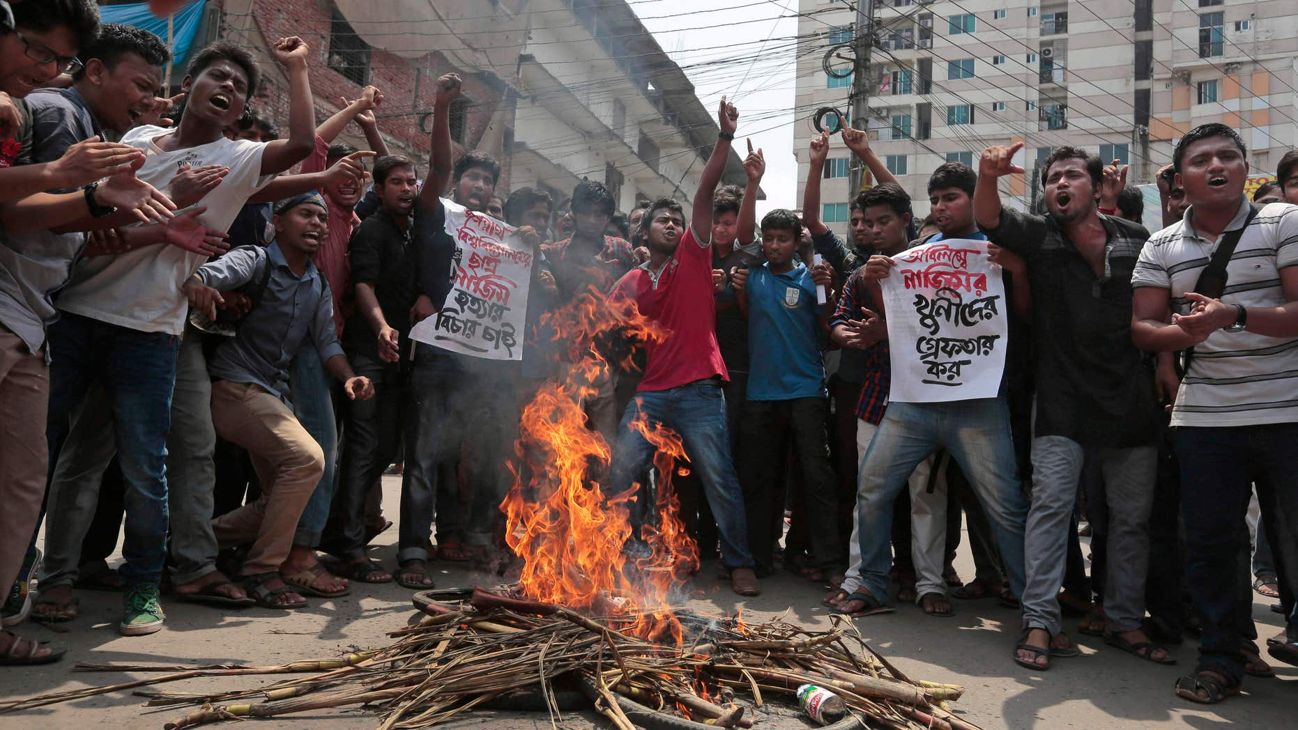 April 7, 2016: Bangladeshi students protest seeking arrest of three motorcycle-riding assailants who hacked student activist Nazimuddin Samad to death as he walked with a friend, in Dhaka, Bangladesh.