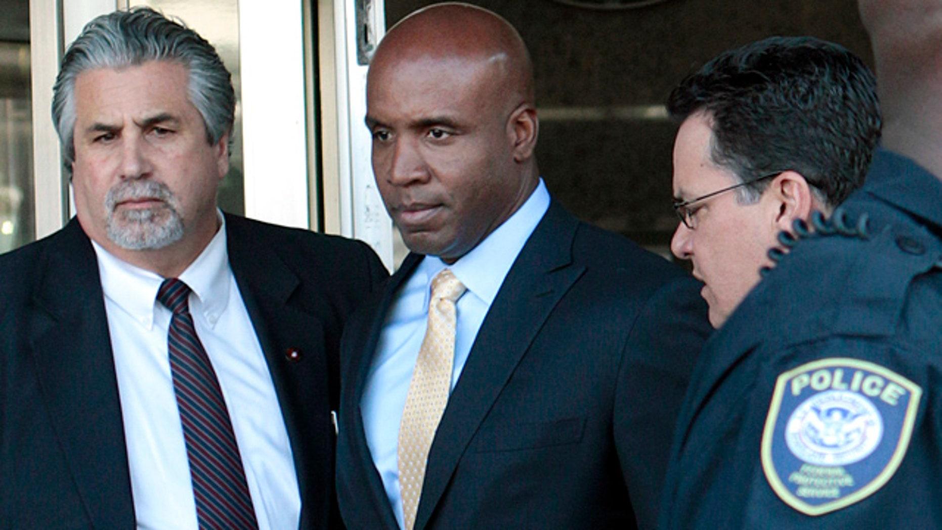 April 7: Former baseball player Barry Bonds, center, leaves federal court in San Francisco.