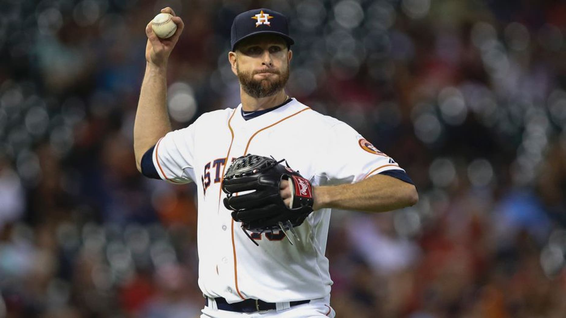 Apr 8, 2015; Houston, TX, USA; Houston Astros starting pitcher Scott Feldman (46) throws out a runner at first base during the fifth inning against the Cleveland Indians at Minute Maid Park. Mandatory Credit: Troy Taormina-USA TODAY Sports