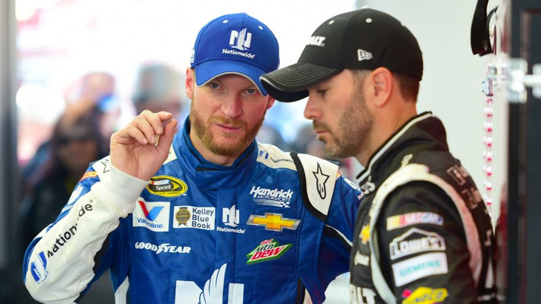 Dale Earnhardt Jr., driver of the #88 Nationwide Chevrolet, speaks with Jimmie Johnson, driver of the #48 Kobalt Tools Chevrolet, in the garage during qualifying for the NASCAR XFINITY Series Boyd Gaming 300 at Las Vegas Motor Speedway on March 7, 2015 in Las Vegas, Nevada. (Photo by Robert Laberge/Getty Images)