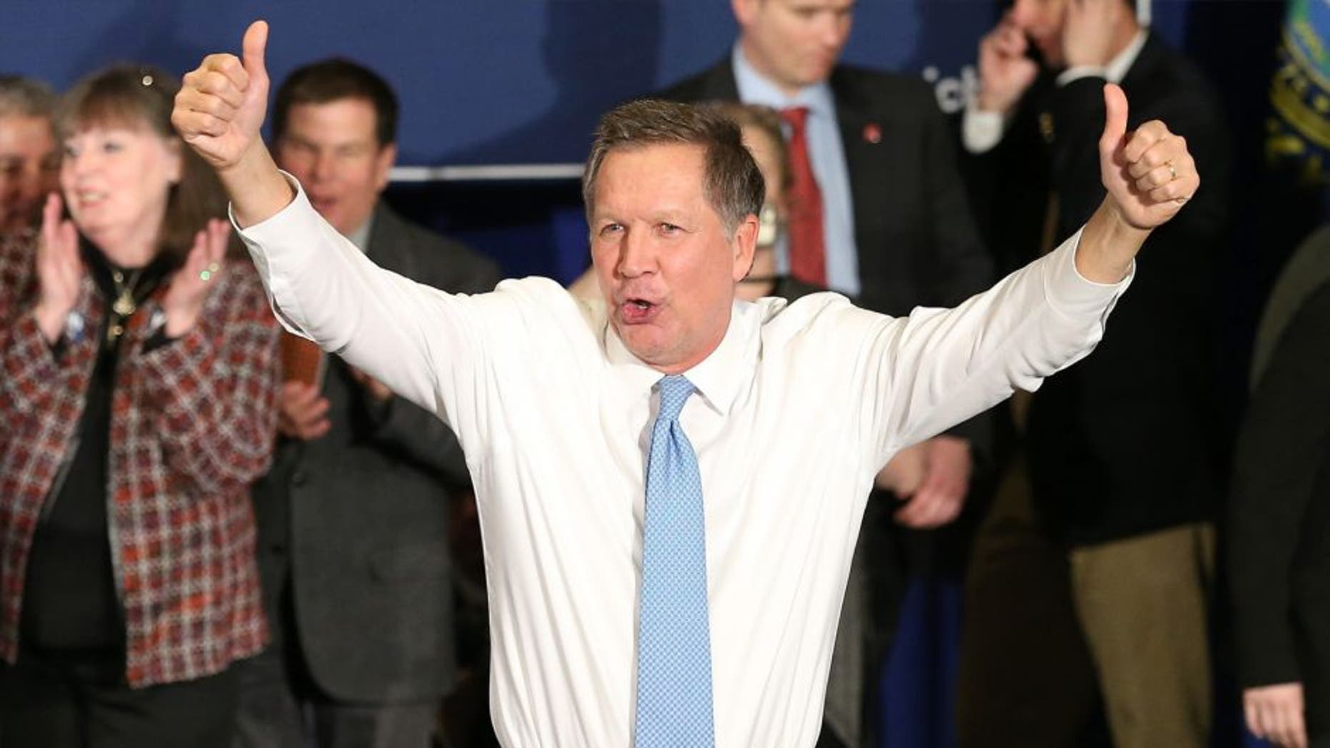 Republican presidential candidate Ohio Governor John Kasich waves to the crowd after speaking at a campaign gathering with supporters upon placing second place in the New Hampshire republican primary on February 9, 2016 in Concord, New Hampshire. Kasich lost the Republican primary to Donald Trump, though he upset fellow Republican governors Chris Christie and former Governor Jeb Bush. (Photo by Andrew Burton/Getty Images)