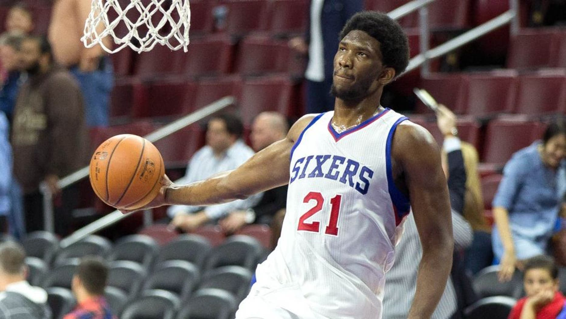 Apr 15, 2015; Philadelphia, PA, USA; Injured Philadelphia 76ers center Joel Embiid (21) dunks during warm ups before playing against the Miami Heat at Wells Fargo Center. Mandatory Credit: Bill Streicher-USA TODAY Sports