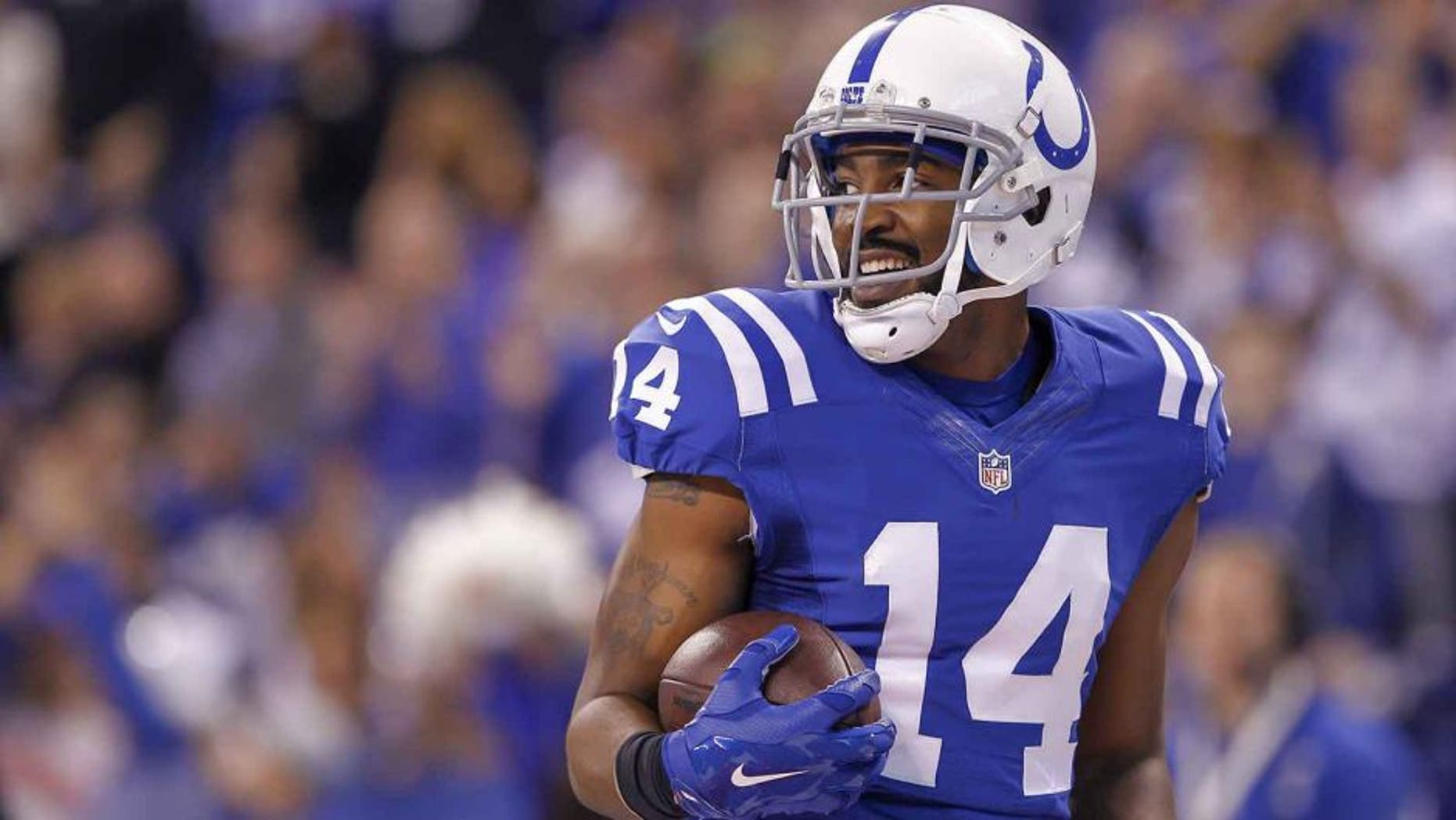 INDIANAPOLIS, IN - DECEMBER 14: Hakeem Nicks #14 of the Indianapolis Colts runs the ball against the Houston Texans at Lucas Oil Stadium on December 14, 2014 in Indianapolis, Indiana. (Photo by Michael Hickey/Getty Images)