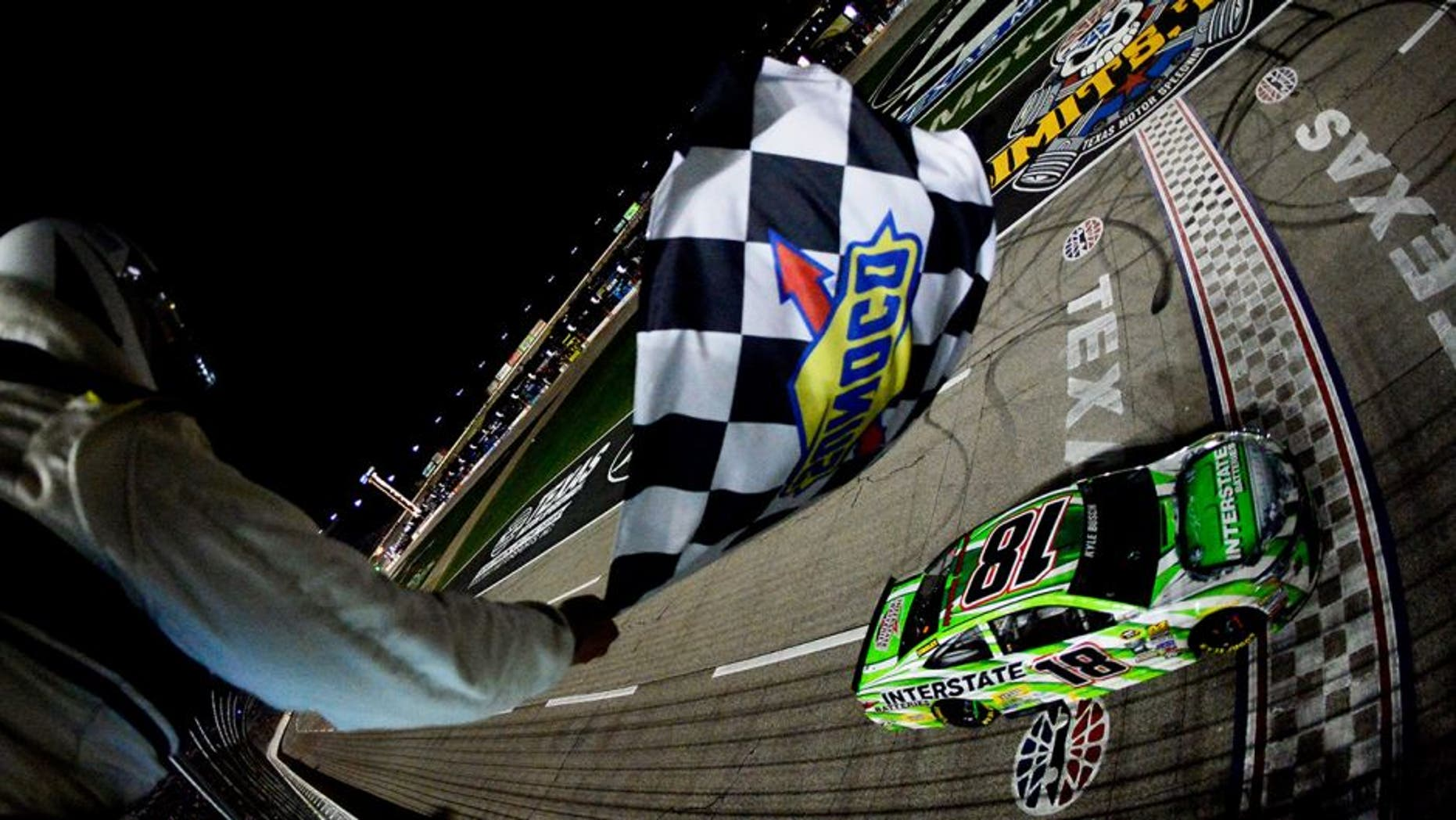 FORT WORTH, TEXAS - APRIL 09: Kyle Busch, driver of the #18 Interstate Batteries Toyota, takes the checkered flag to win the NASCAR Sprint Cup Series Duck Commander 500 at Texas Motor Speedway on April 9, 2016 in Fort Worth, Texas. (Photo by Robert Laberge/NASCAR via Getty Images)