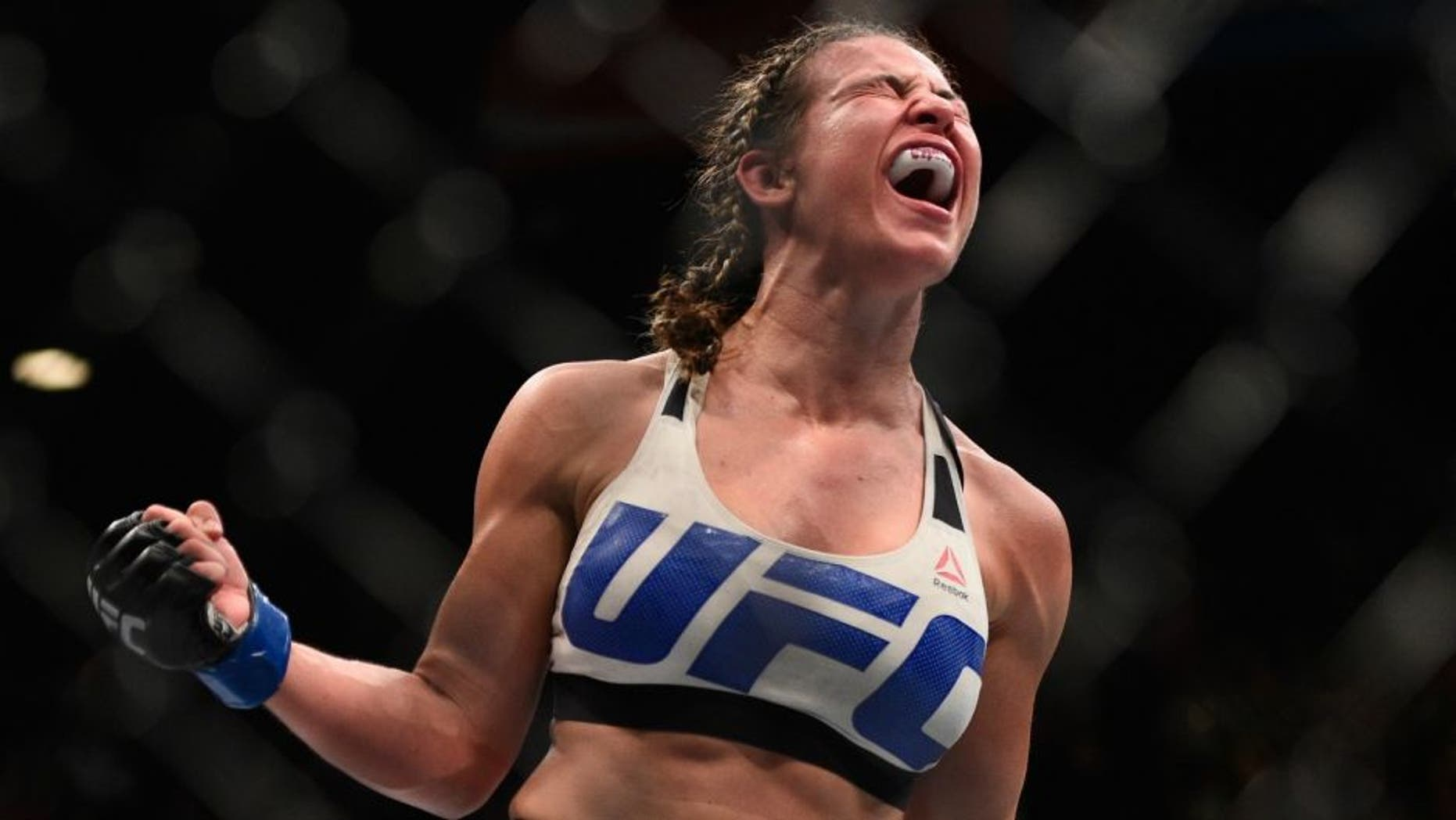Miesha Tate celebrates after defeating Holly Holm during the UFC 196 event inside MGM Grand Garden Arena on March 5, 2016 in Las Vegas, Nevada. (Photo by Jeff Bottari/Zuffa LLC/Zuffa LLC via Getty Images)