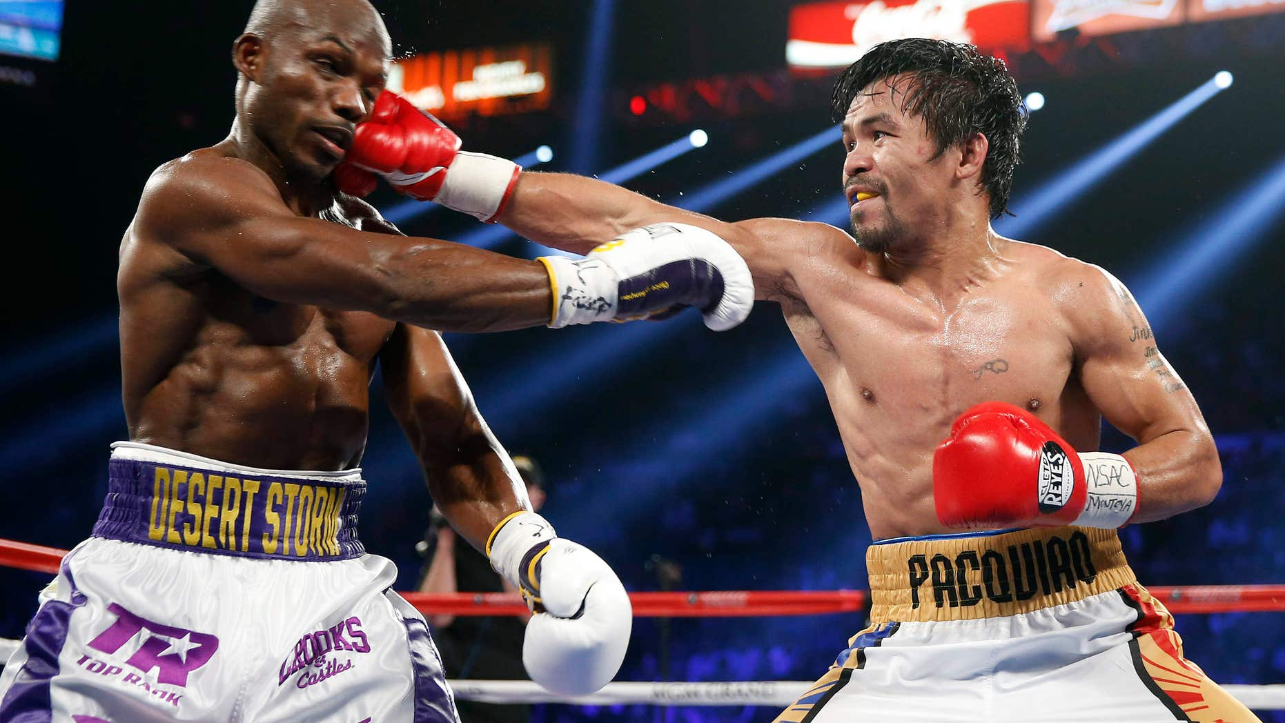 Manny Pacquiao, right, of the Philippines, hits Timothy Bradley during their WBO welterweight title boxing bout Saturday, April 9, 2016, in Las Vegas.