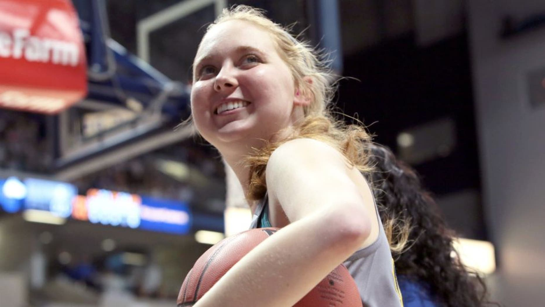 CINCINNATI - NOVEMBER 2: Freshman Lauren Hill of Mount St. Joseph smiles during a game at Xavier University in Cincinnati Ohio at the Cintas Center. NOTE TO USER: User expressly acknowledges and agrees that, by downloading and or using this Photograph, user is consenting to the terms and condition of the Getty Images License Agreement. Mandatory Copyright Notice: 2014 NBAE (Photo by Ron Hoskins/NBAE via Getty Images)