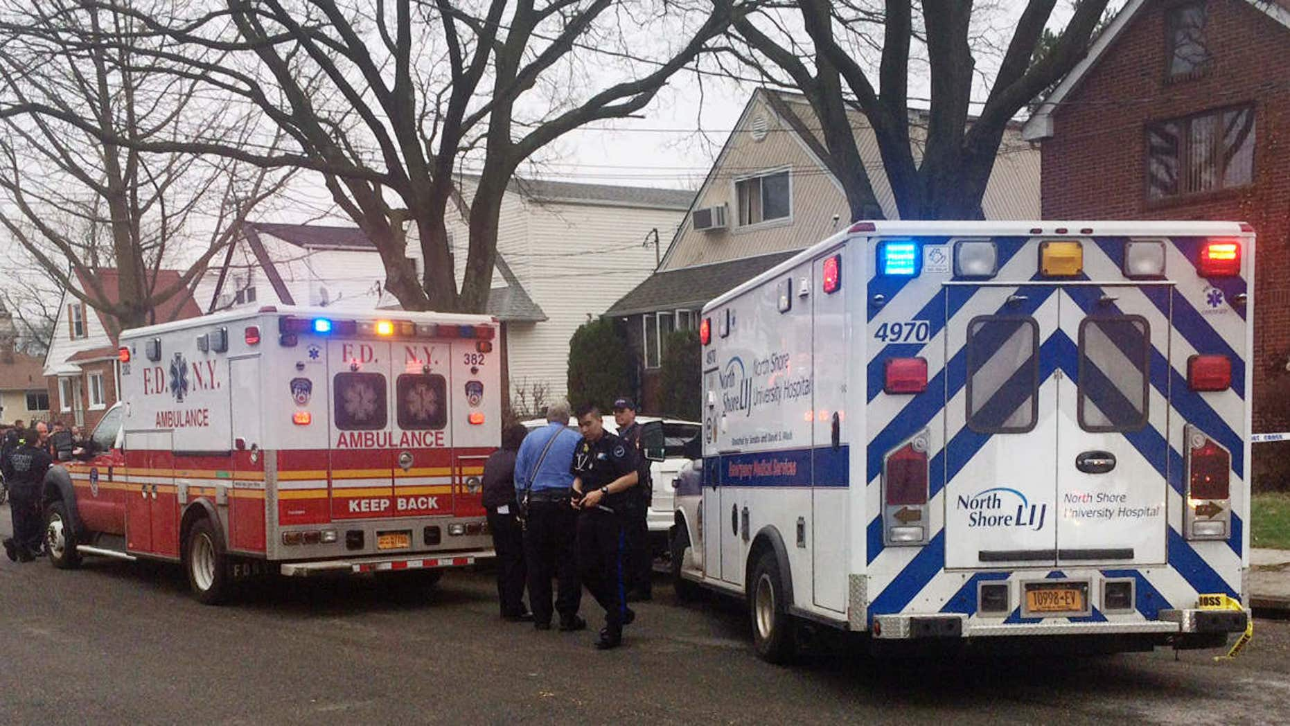 April 10, 2015: Emergency personel gather near a home where police say four people were found dead in an apparent carbon monoxide poisoning in the Queens borough of New York.