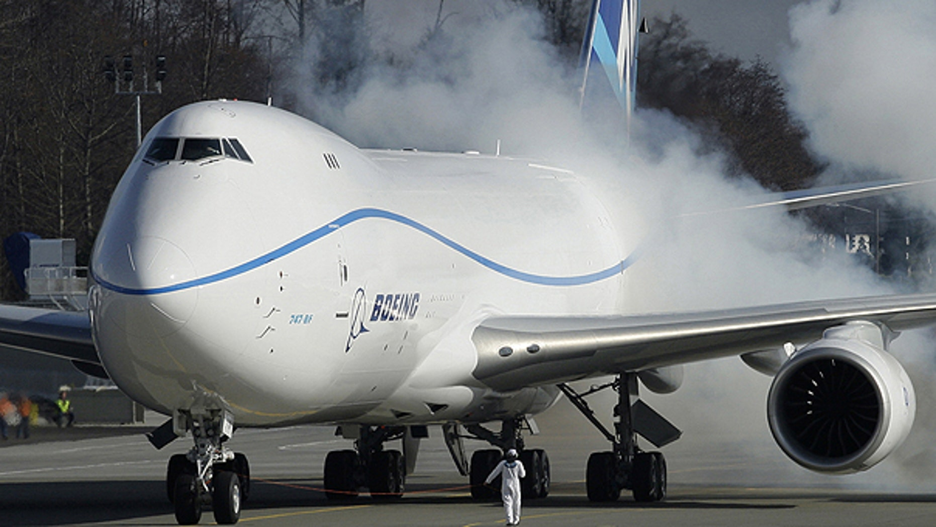 In this Feb. 8, 2010 file photo, engines on the Boeing 747-8 Freighter are started just prior to the plane's first flight, in Everett, Wash.