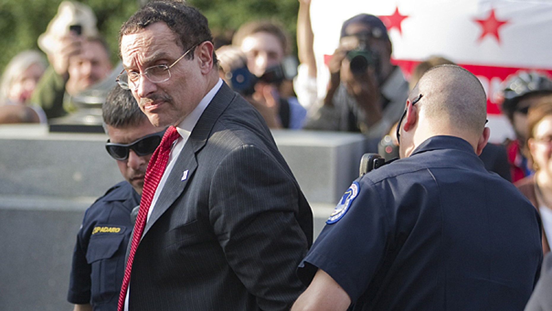 April 11: Mayor Vincent Gray is searched by Capitol Hill police after being arrested in Washington.
