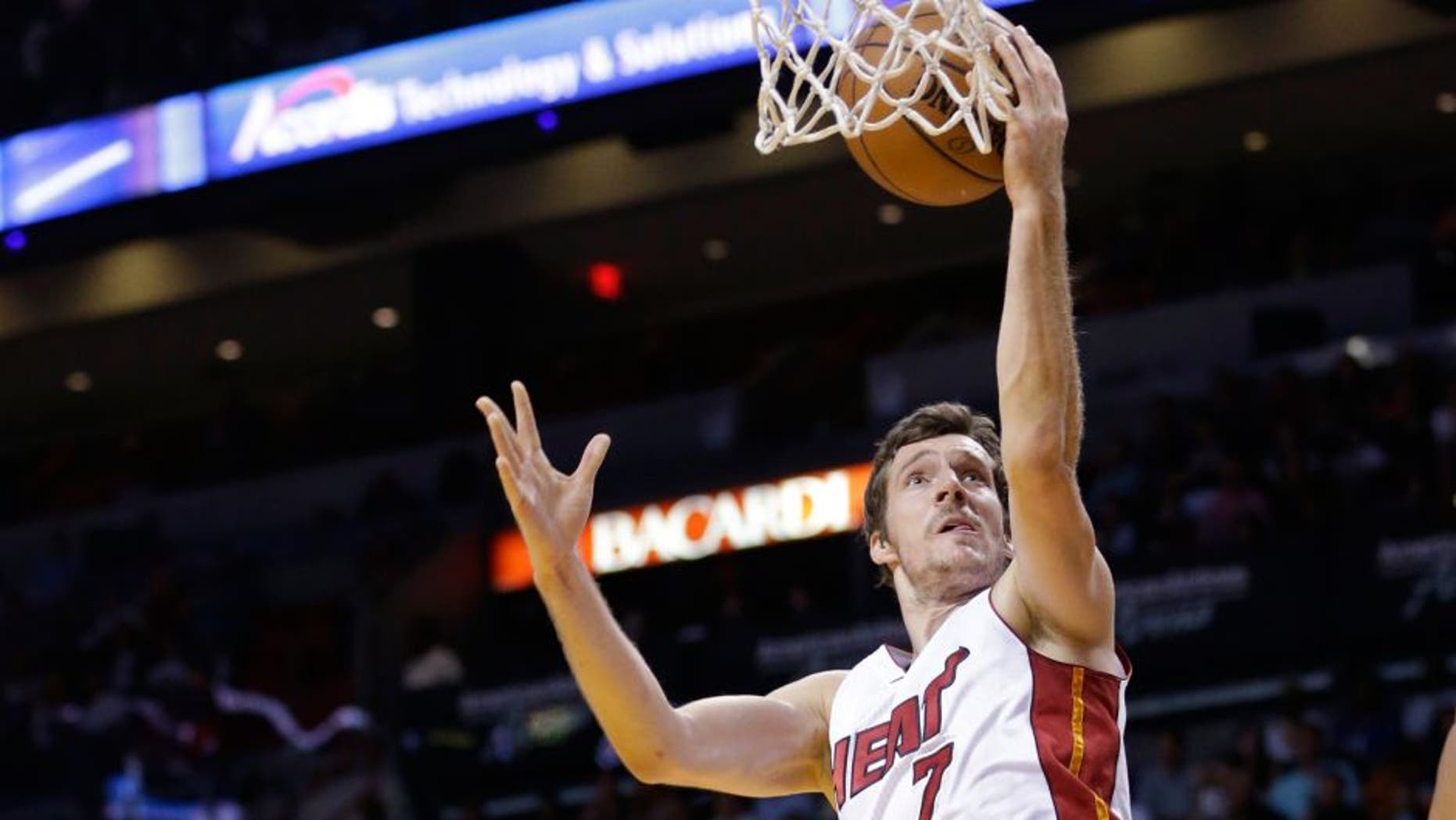Miami Heat guard Goran Dragic (7) of Slovenia, goes up for a shot during the first half of an NBA basketball game against the Toronto Raptors, Saturday, April 11, 2015, in Miami. (AP Photo/Wilfredo Lee)