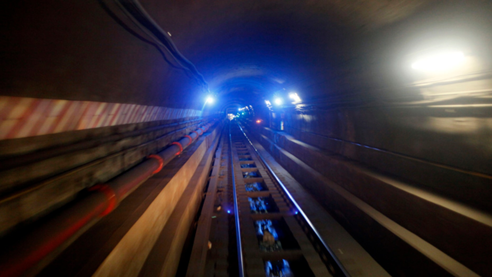In this April 1, 2010 photo, the tunnel connecting  the Bowling Green station in Manhattan to the  Borough Hall station in Brooklyn on the 4 train line is seen in New York.  (AP Photo/Mary Altaffer)