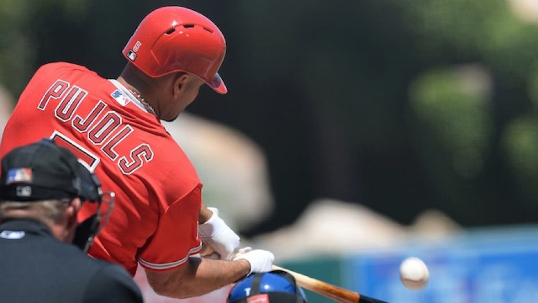 Apr 12, 2015; Anaheim, CA, USA; Los Angeles Angels first baseman Albert Pujols (5) connects for a solo home run in the first inning of the game against the Kansas City Royals at Angel Stadium of Anaheim. Mandatory Credit: Jayne Kamin-Oncea-USA TODAY Sports