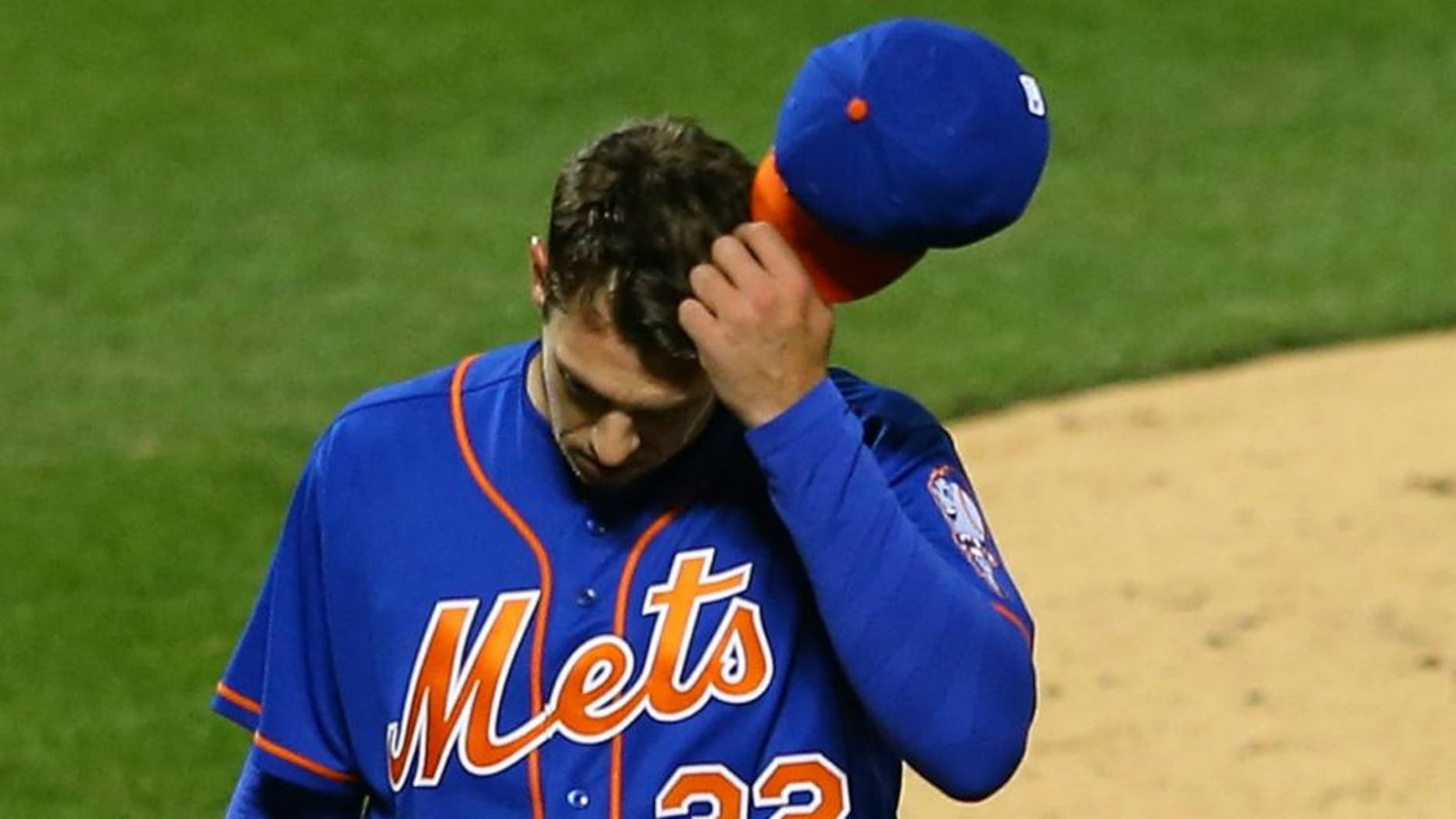 NEW YORK, NEW YORK - APRIL 11: Steven Matz #32 of the New York Mets walks off the mound after giving up 7-runs in the second inning against the Miami Marlins at Citi Field on April 11, 2016 in the Flushing neighborhood of the Queens borough of New York City. (Photo by Mike Stobe/Getty Images)