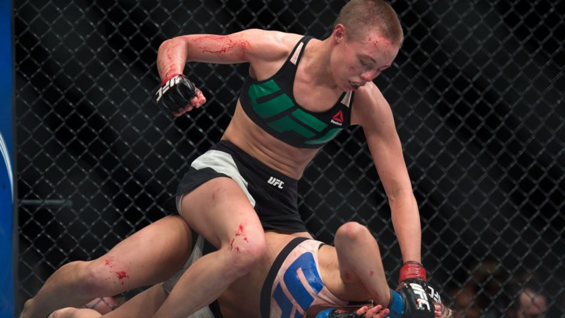 LAS VEGAS, NEVADA - DECEMBER 10: (Top) Rose Namajunas punches Paige VanZant in their women's strawweight bout during the UFC Fight Night event at The Chelsea at the Cosmopolitan of Las Vegas on December 10, 2015 in Las Vegas, Nevada. (Photo by Brandon Magnus/Zuffa LLC/Zuffa LLC via Getty Images)