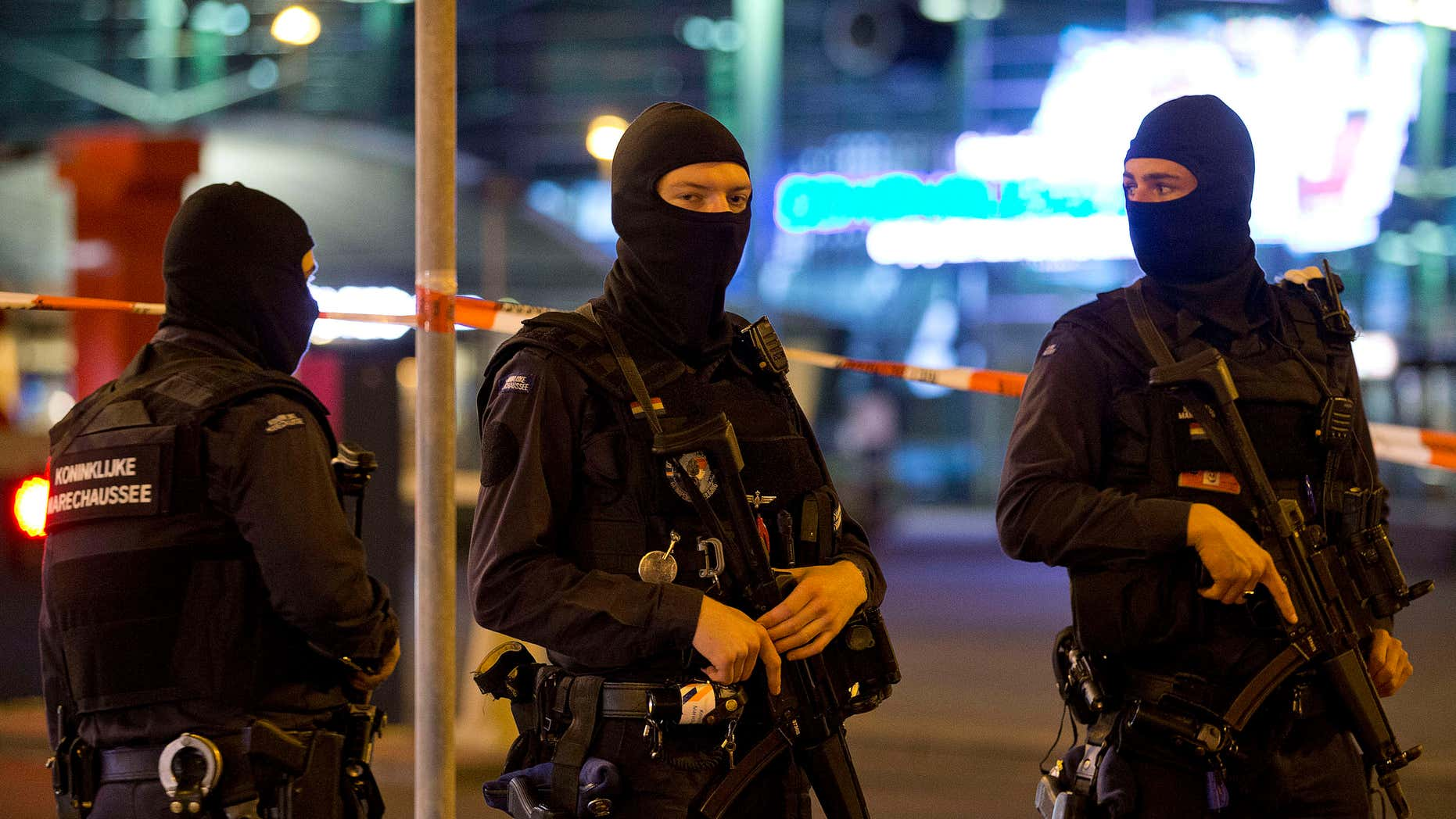 April 13, 2016: Hooded military police officers guard a part of Schiphol Aiport in Amsterdam, Netherlands.