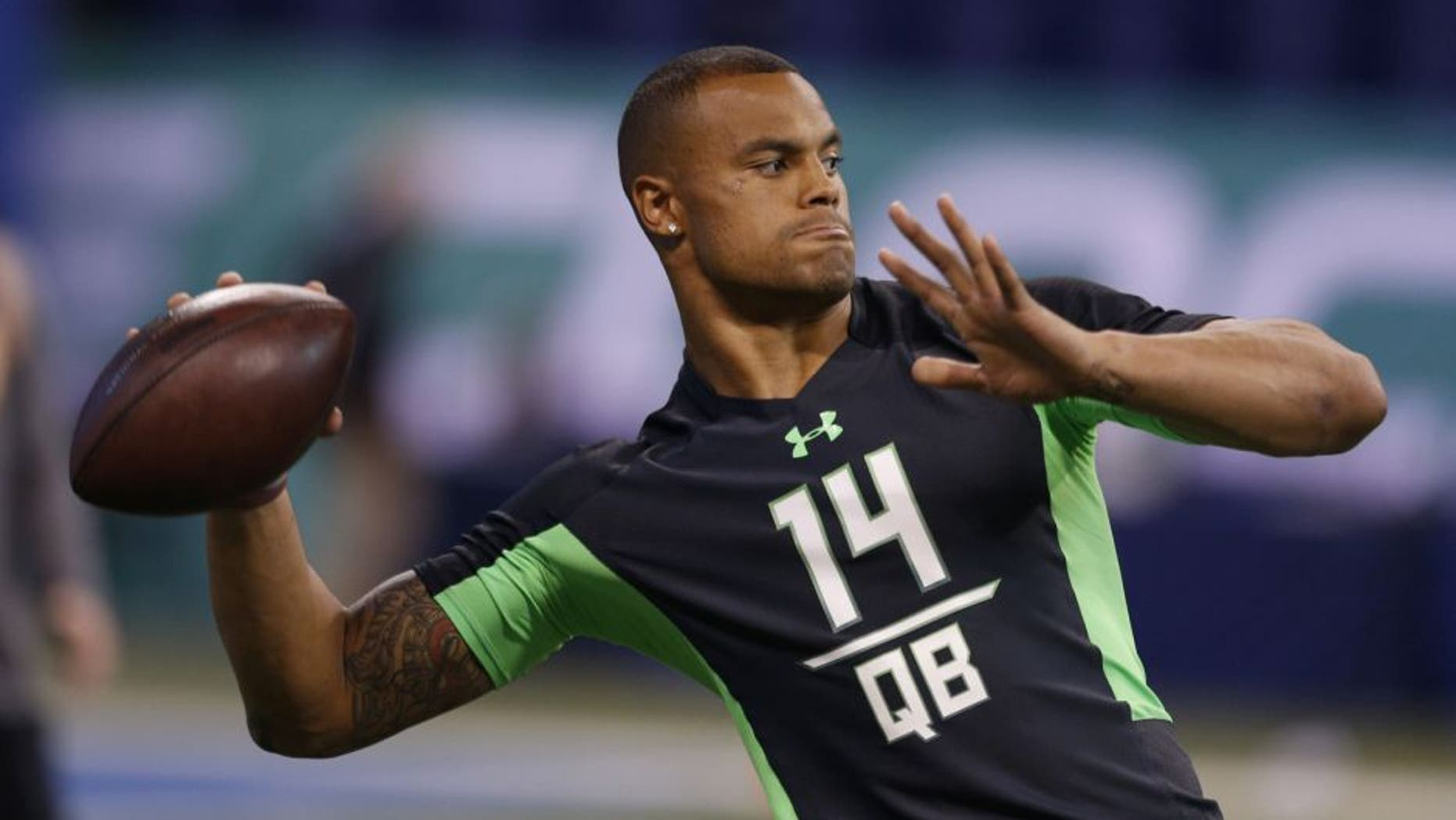 Mississippi State Bulldogs quarterback Dak Prescott throws a pass during the 2016 NFL Scouting Combine at Lucas Oil Stadium. Mandatory Credit: Brian Spurlock-USA TODAY Sports