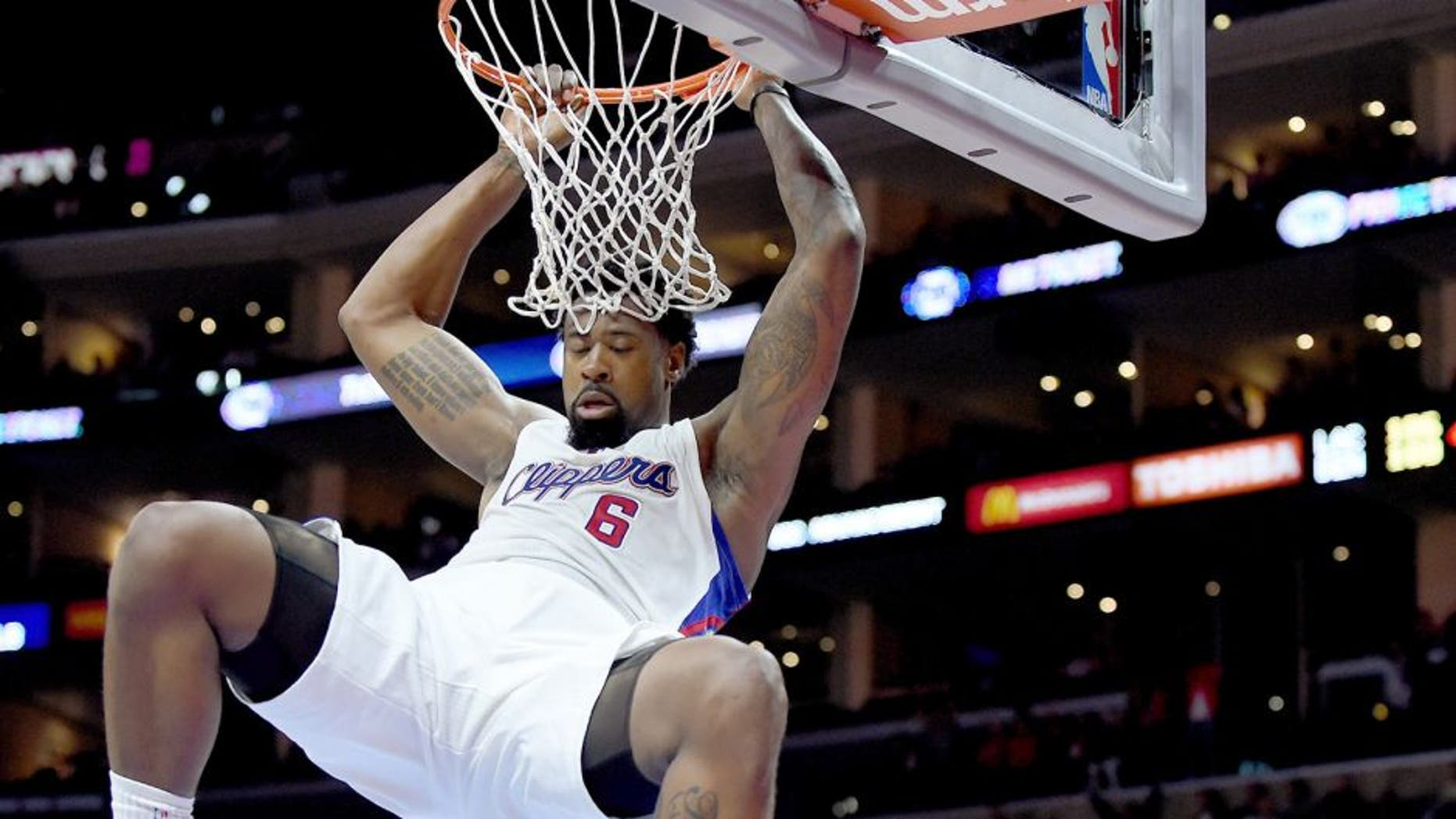 LOS ANGELES, CA - APRIL 13: DeAndre Jordan #6 of the Los Angeles Clippers scores on a dunk in front of Randy Foye #4 of the Denver Nuggets during a 110-103 Clipper win at Staples Center on April 13, 2015 in Los Angeles, California. NOTE TO USER: User expressly acknowledges and agrees that, by downloading and or using this Photograph, user is consenting to the terms and condition of the Getty Images License Agreement. (Photo by Harry How/Getty Images)