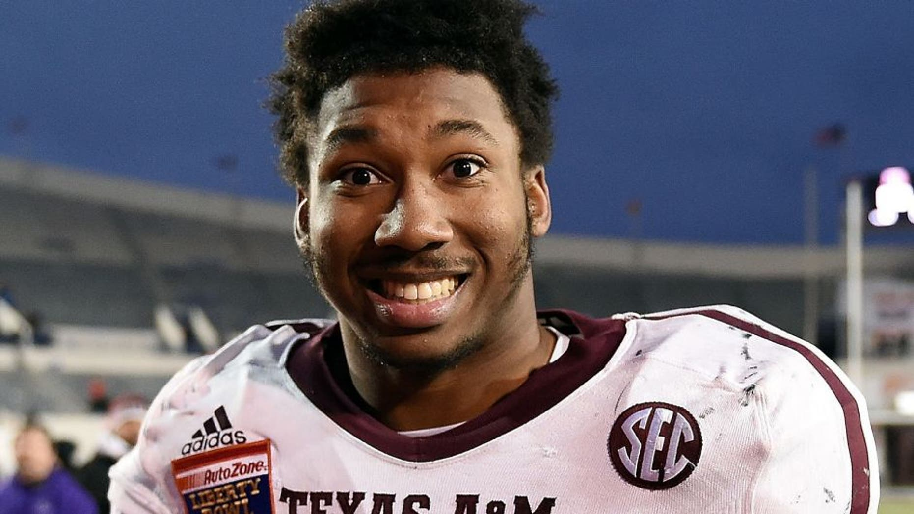 MEMPHIS, TN - DECEMBER 29: Myles Garrett #15 of the Texas A&M Aggies leaves the field following a victory over the West Virginia Mountaineers in the 56th annual Autozone Liberty Bowl at Liberty Bowl Memorial Stadium on December 29, 2014 in Memphis, Tennessee. Texas A&M won the game 45-37. (Photo by Stacy Revere/Getty Images)