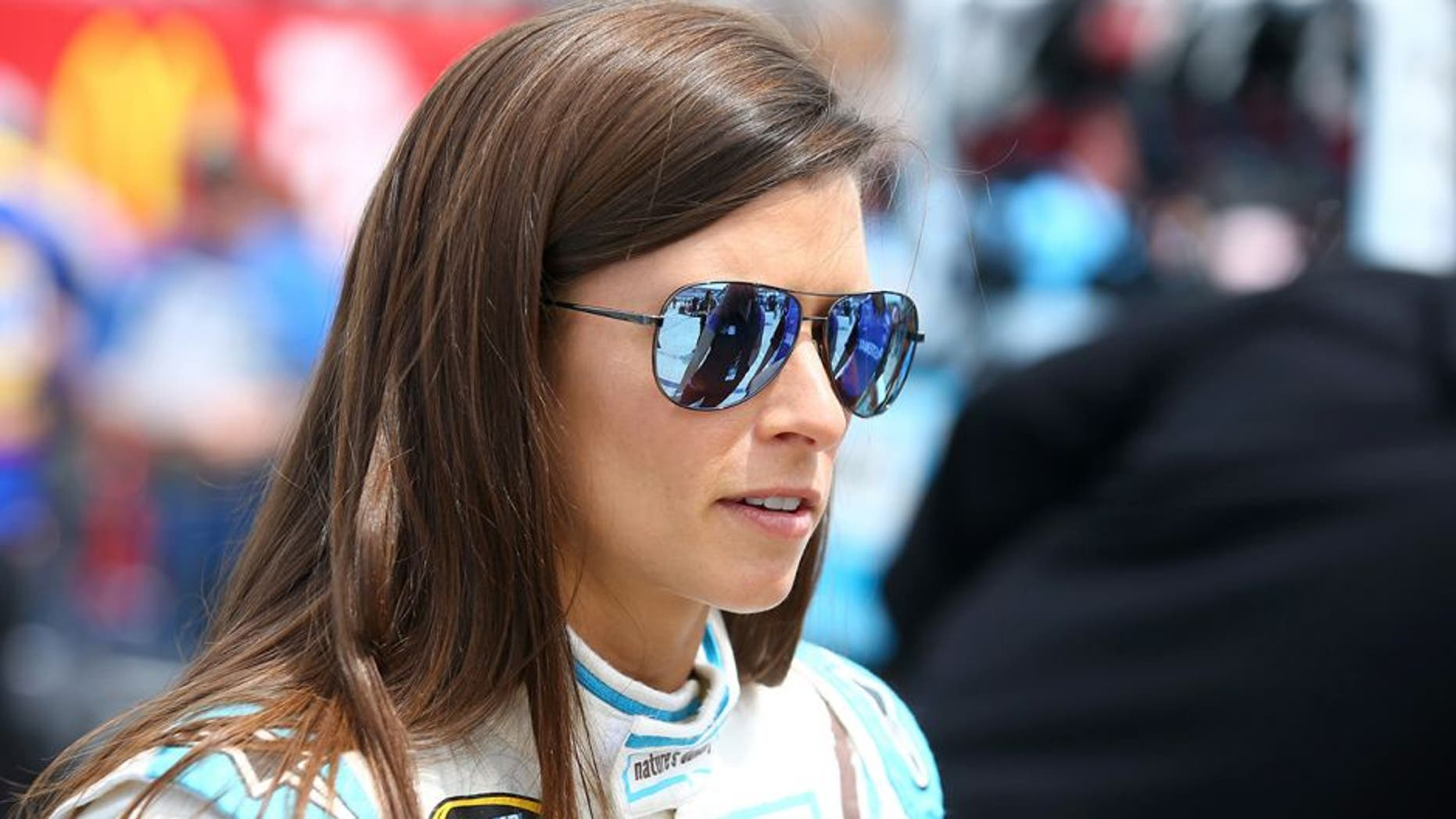 FORT WORTH, TEXAS - APRIL 08: Danica Patrick, driver of the #10 Nature's Bakery Chevrolet, stands on the grid during qualifying for the NASCAR Sprint Cup Series Duck Commander 500 at Texas Motor Speedway on April 8, 2016 in Fort Worth, Texas. (Photo by Sarah Crabill/Getty Images for Texas Motor Speedway)