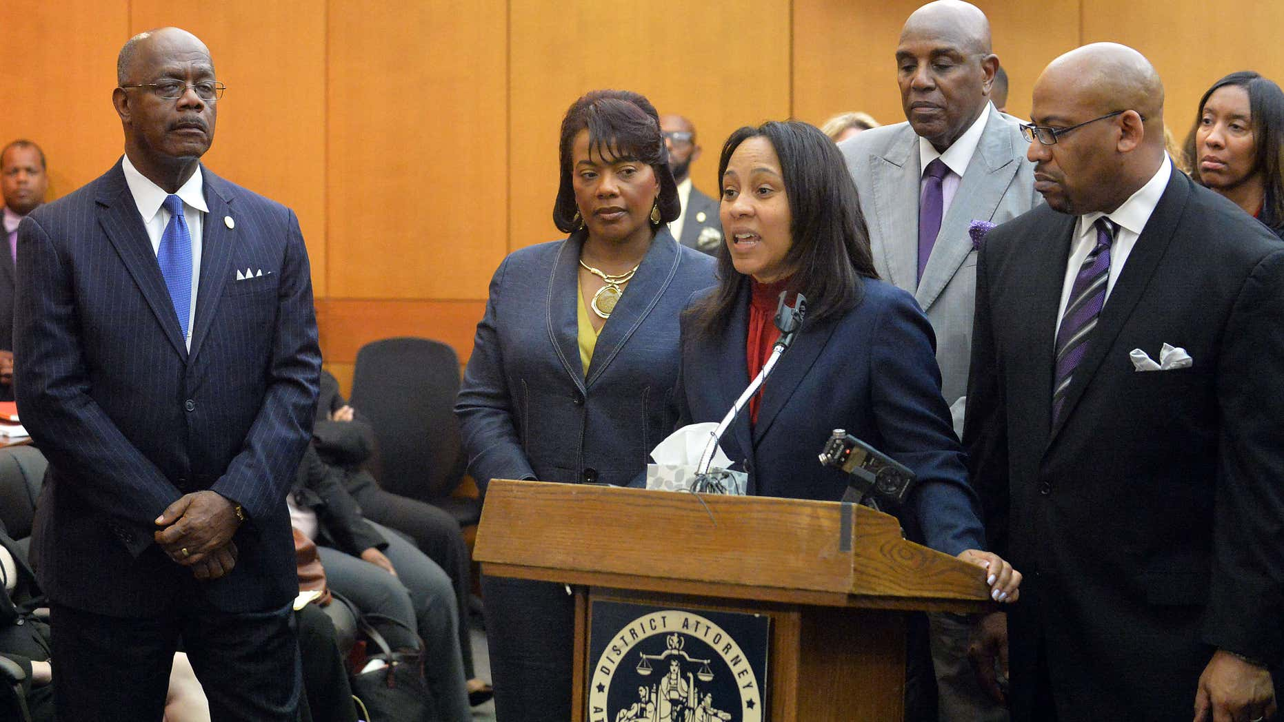 April 14, 2015: Prosecutors Fani Willis and Clint Rucker speak during a news conference following sentencing for 10 of the 11 defendants convicted in the Atlanta Public Schools test-cheating trial