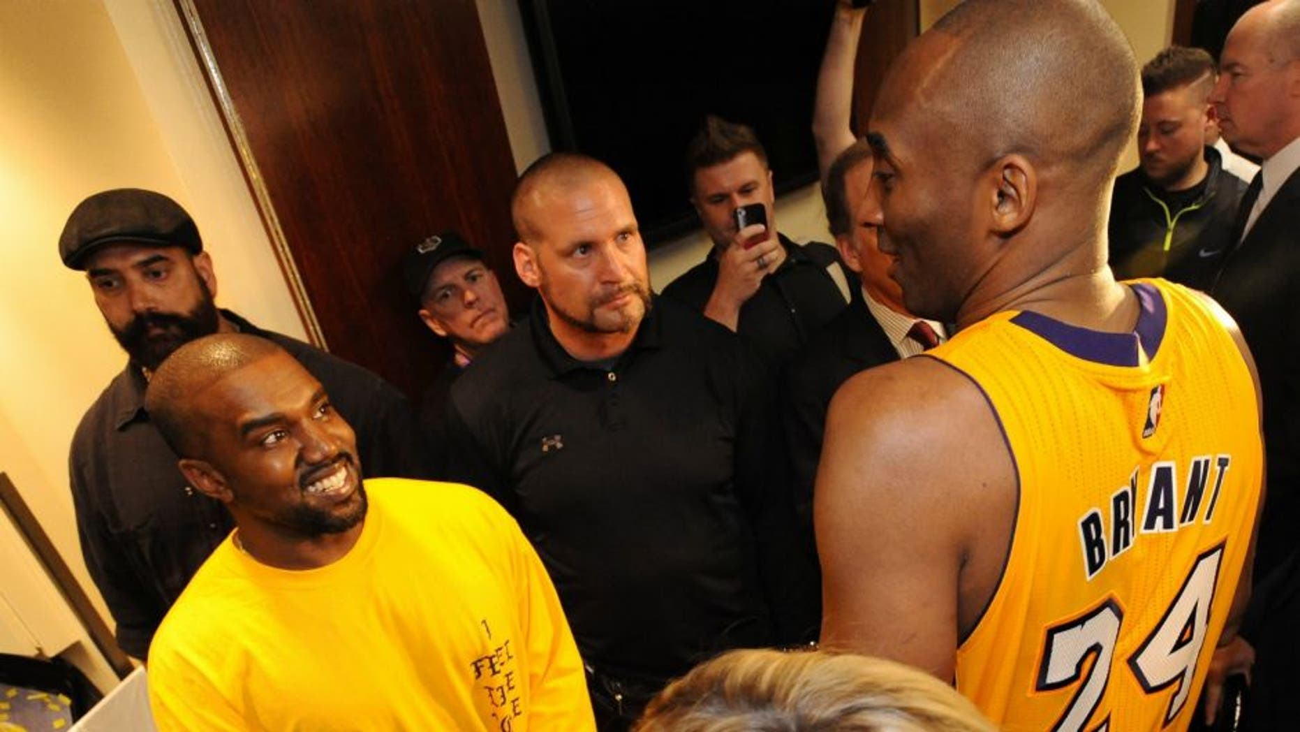 LOS ANGELES, CA - APRIL 13: Rapper, Kanye West talks to Kobe Bryant #24 of the Los Angeles Lakers after the game on April 13, 2016 at Staples Center in Los Angeles, California. NOTE TO USER: User expressly acknowledges and agrees that, by downloading and/or using this Photograph, user is consenting to the terms and conditions of the Getty Images License Agreement. Mandatory Copyright Notice: Copyright 2016 NBAE (Photo by Andrew D. Bernstein/NBAE via Getty Images)