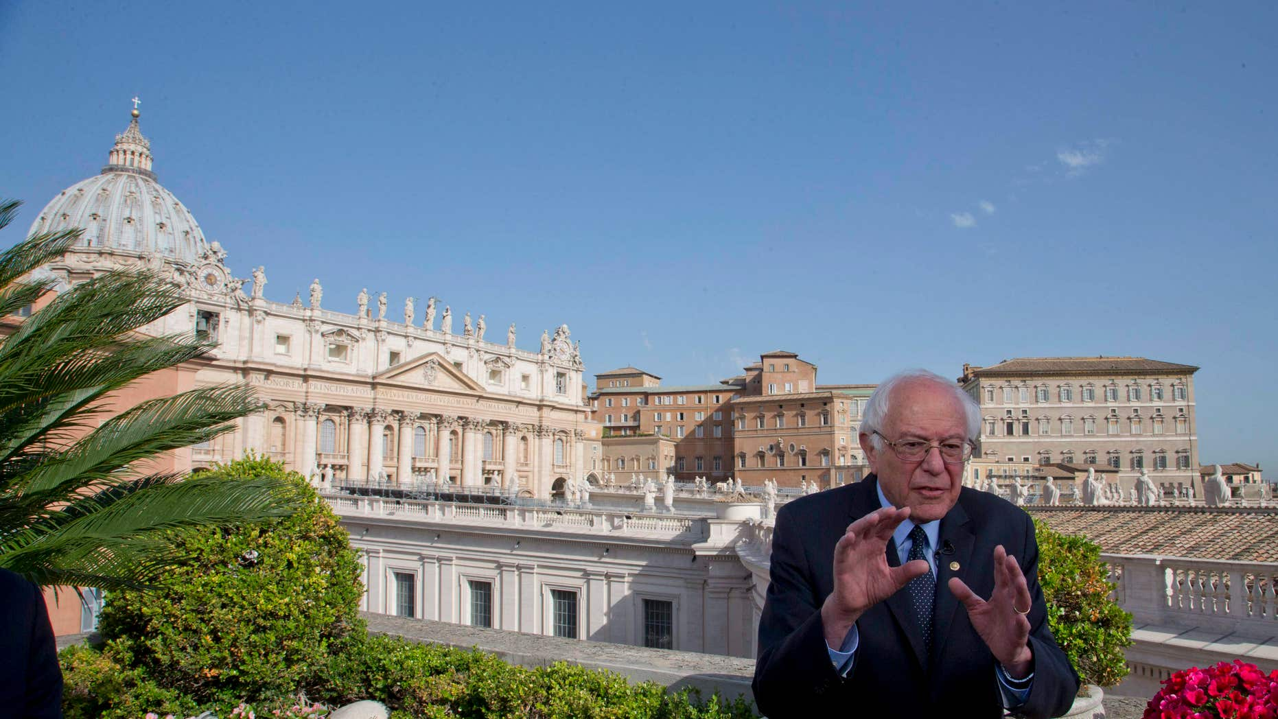 April 16, 2016: US presidential candidate Bernie Sanders, backdropped by St. Peter's Basilica, talks during an interview with the Associated Press, at the Vatican.