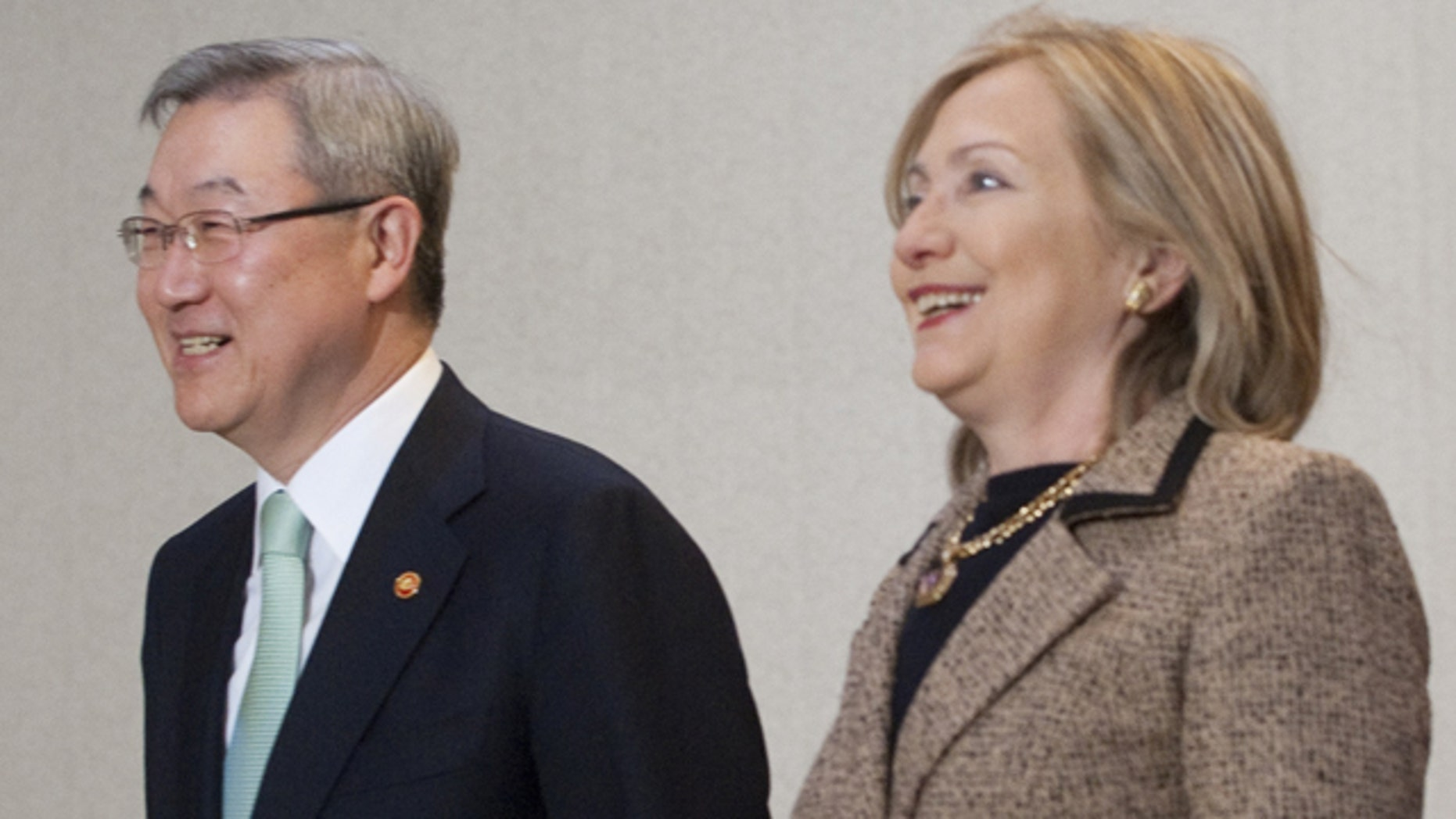 April 16: South Korean Foreign Minister Kim Sung-Hwan, left, walks together with U.S. Secretary of State Hillary Rodham Clinton to a meeting room at the Foreign Minister's Residence in Seoul, South Korea.