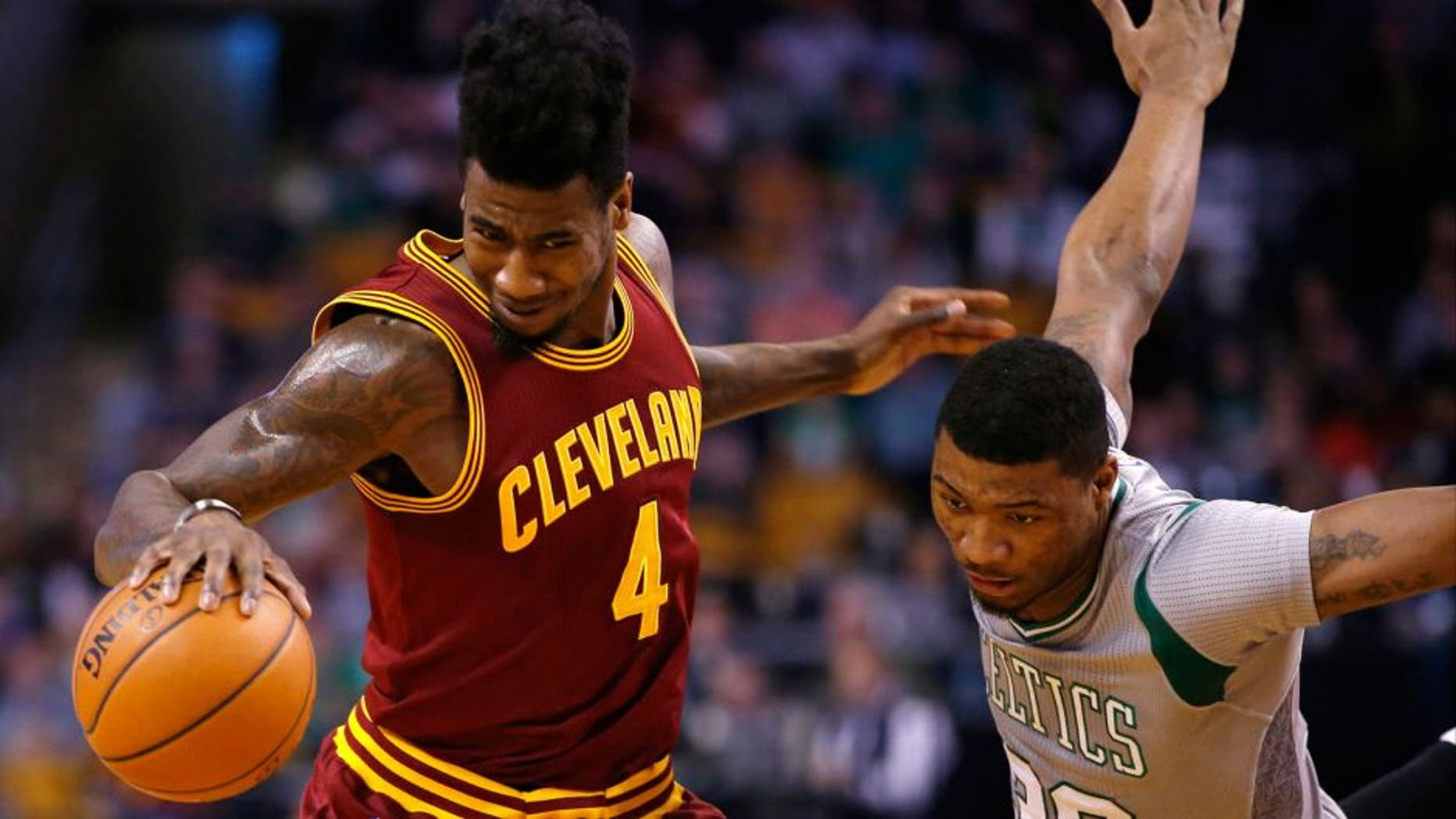 Apr 12, 2015; Boston, MA, USA; Cleveland Cavaliers guard Iman Shumpert (4) works the ball against Boston Celtics guard Marcus Smart (36) in the first half at TD Garden. The Celtics defeated the Cleveland Cavaliers 117-78. Mandatory Credit: David Butler II-USA TODAY Sports