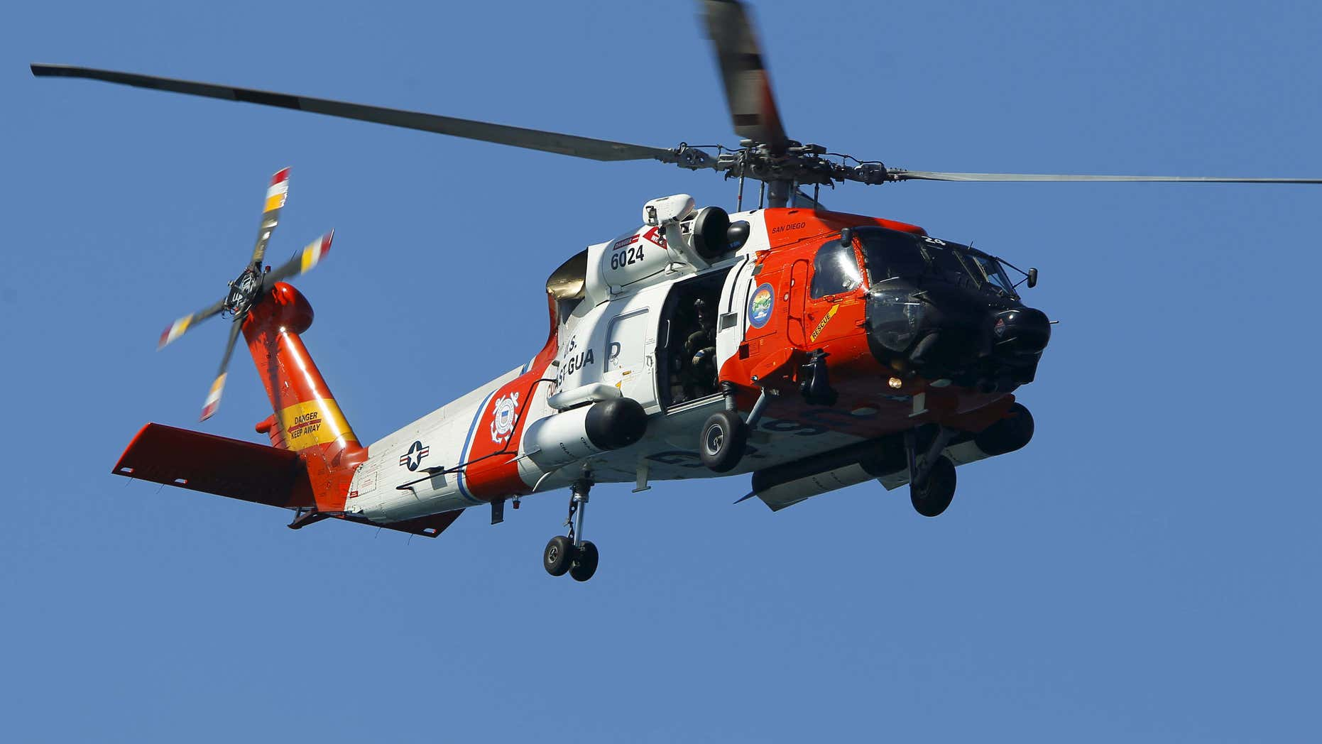 Sept. 30, 2015: A U.S. Coast Guard helicopter hovers over as first responders take part in a mass-rescue exercise centering around a mock airliner crash-landing in the sea near Ocean Beach, Calif.
