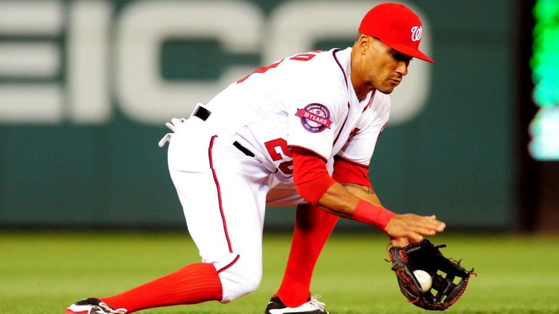 Apr 16, 2015; Washington, DC, USA; Washington Nationals shortstop Ian Desmond (20) fields a ground ball during the game against the Philadelphia Phillies at Nationals Park. The Nationals won 5-2. Mandatory Credit: Evan Habeeb-USA TODAY Sports
