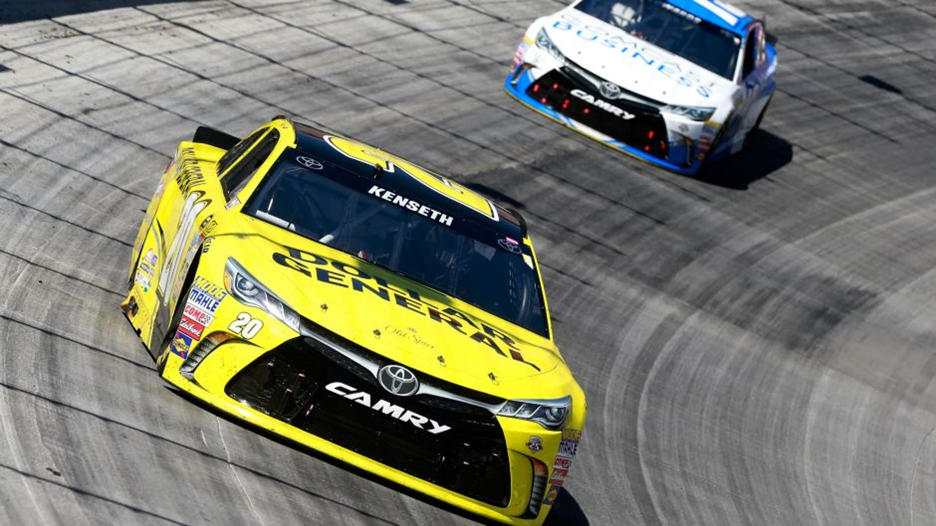 BRISTOL, TN - APRIL 17: Matt Kenseth, driver of the #20 Dollar General Toyota, leads Carl Edwards, driver of the #19 Comcast Business Toyota, during the NASCAR Sprint Cup Series Food City 500 at Bristol Motor Speedway on April 17, 2016 in Bristol, Tennessee. (Photo by Matt Sullivan/Getty Images)
