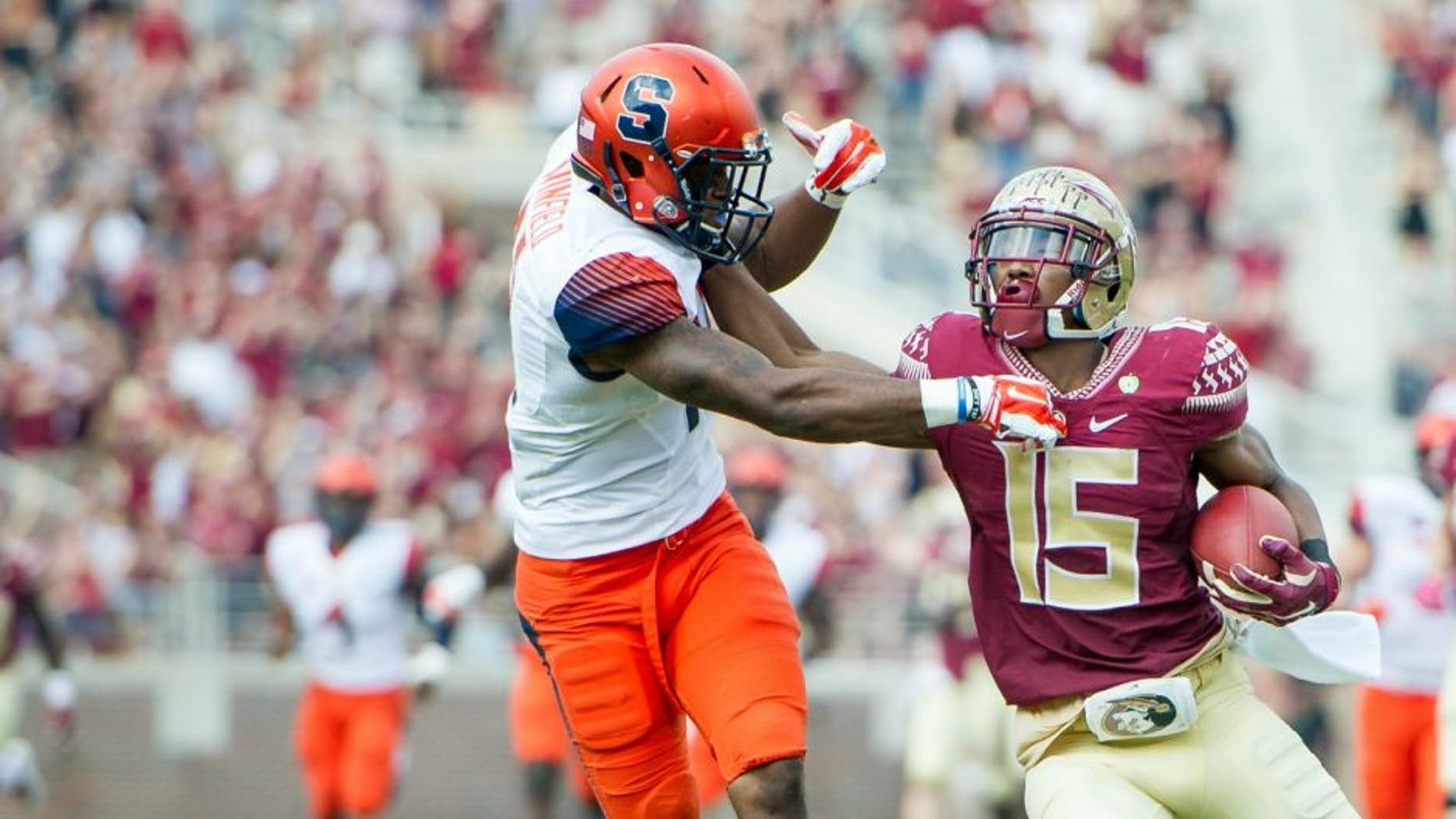TALLAHASSEE, FL - OCTOBER 31: Wide receiver Travis Rudolph #15 of the Florida State Seminoles pushes cornerback Corey Winfield #11 of the Syracuse Orange while running the ball downfield on October 31, 2015 at Doak Campbell Stadium in Tallahassee, FL. (Photo by Michael Chang/Getty Images)