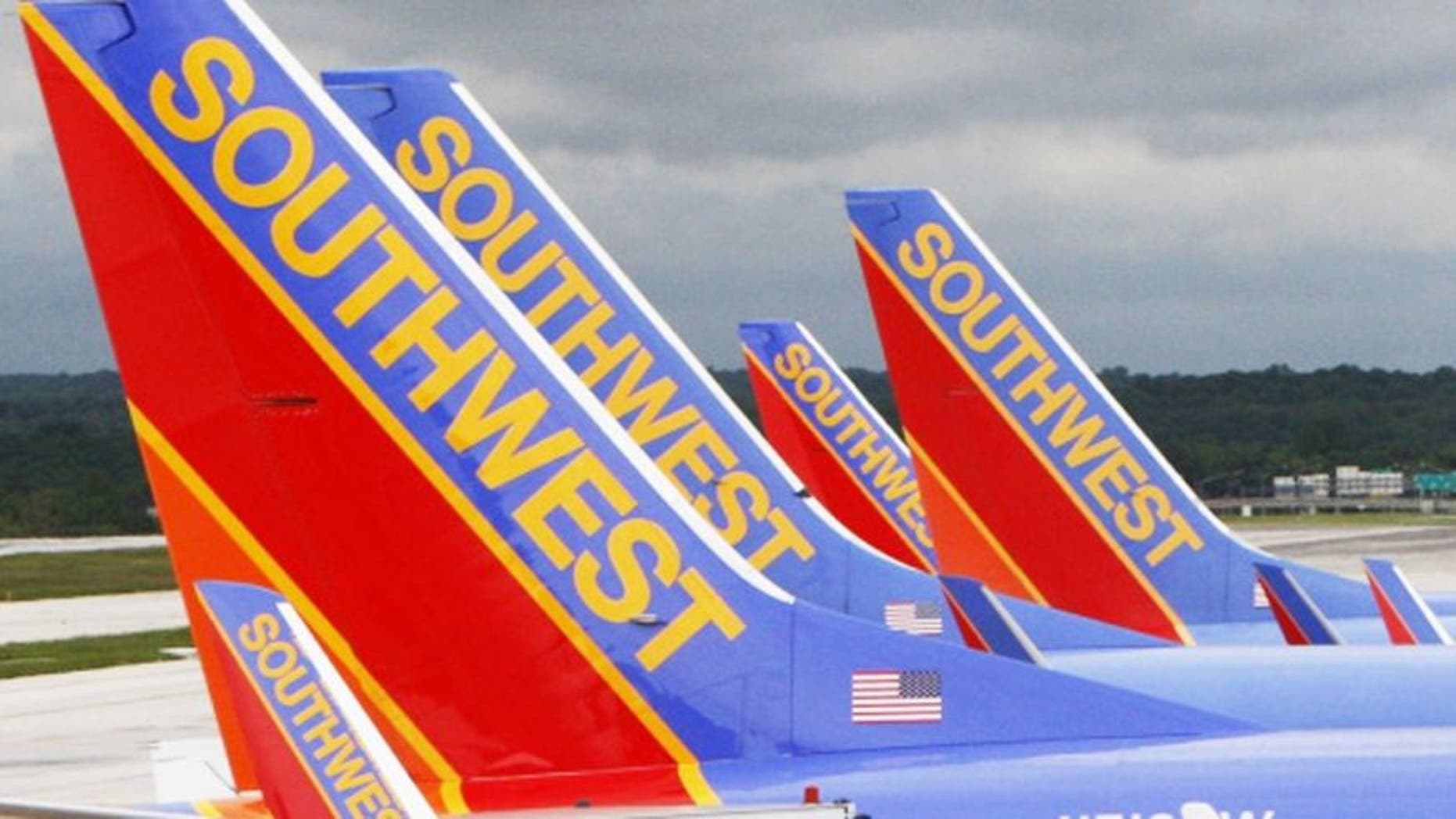 A Southwest Airlines pilot was arrested on a weapons charge in New York Monday after airport security officers discovered a loaded handgun in his carry-on bag.