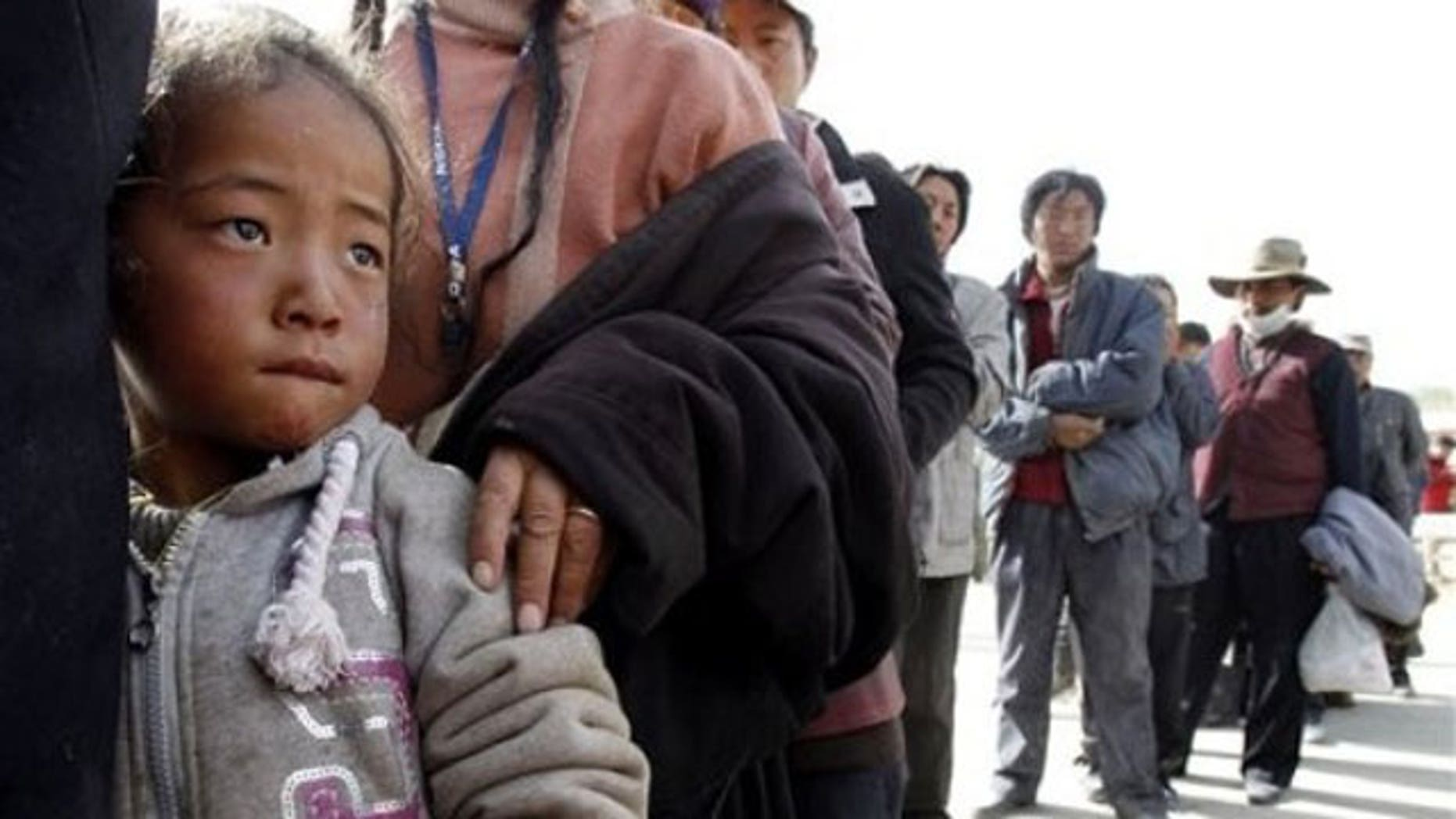 A Tibetan child stands in a line waiting for medical treatment at a temporary hospital set up for quake victims in earthquake-hit Yushu county in west China's Qinghai province (AP).