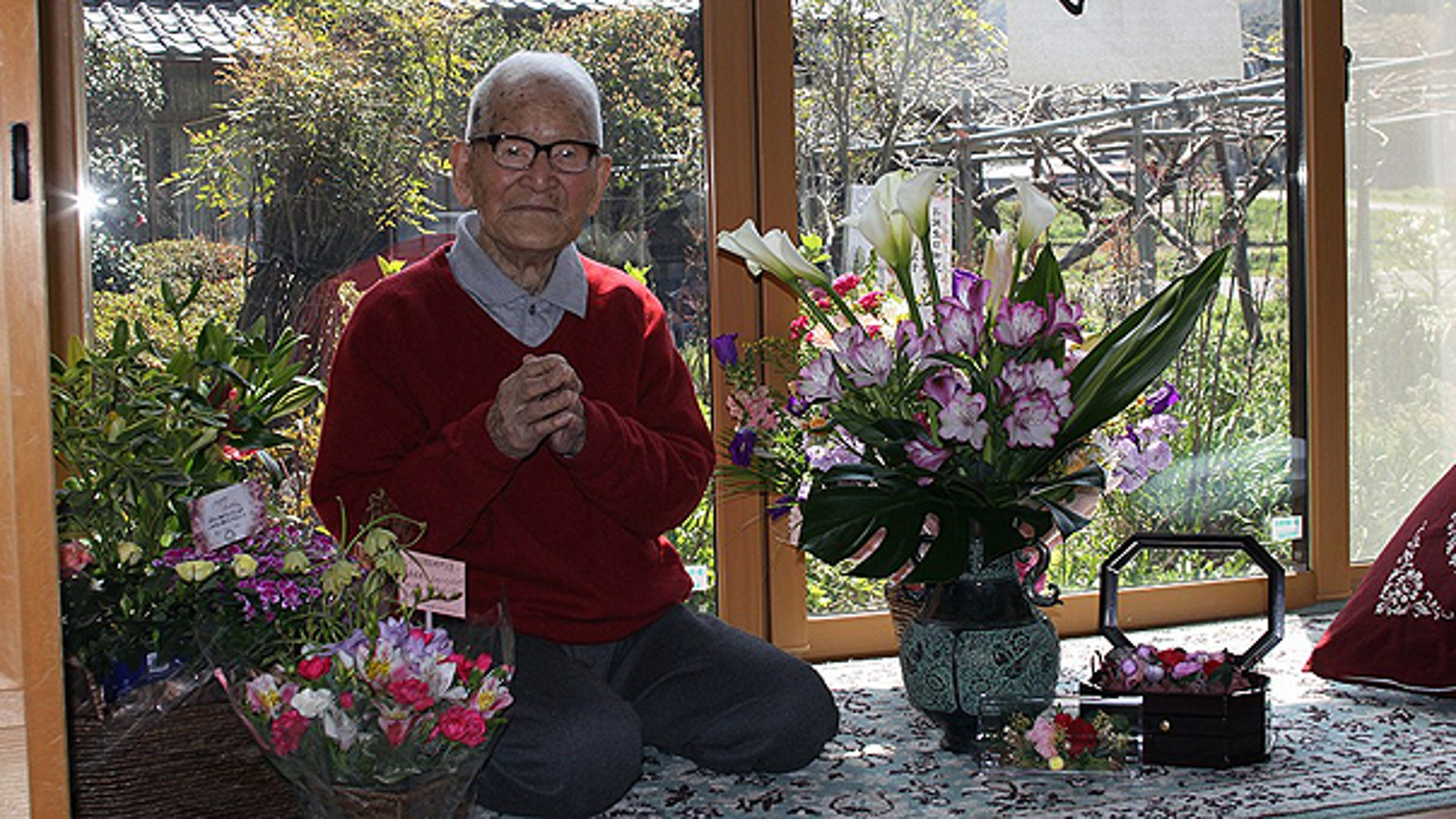 April 19: In this photo released by Kyotango City Office, Jirouemon Kimura poses during his 114th birthday at his home in Kyotango, western Japan.