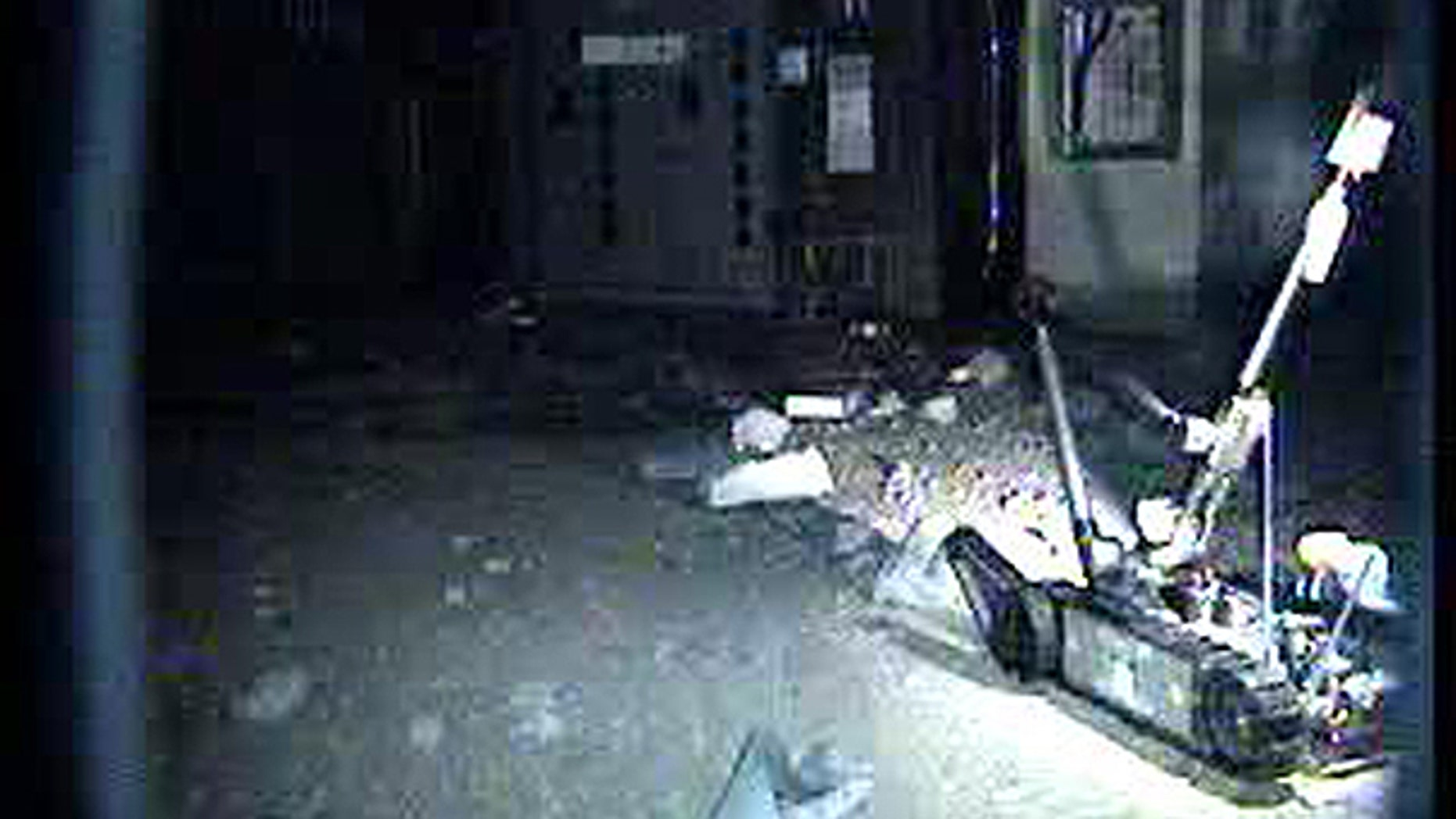 April 17: In this photo released by Tokyo Electric Power Co., a radio-controlled PakBot robot advances inside the reactor building of Unit 1 at the Fukushima Dai-ichi Nuclear Power Plant in Okuma, Fukushima Prefecture, northeastern Japan.