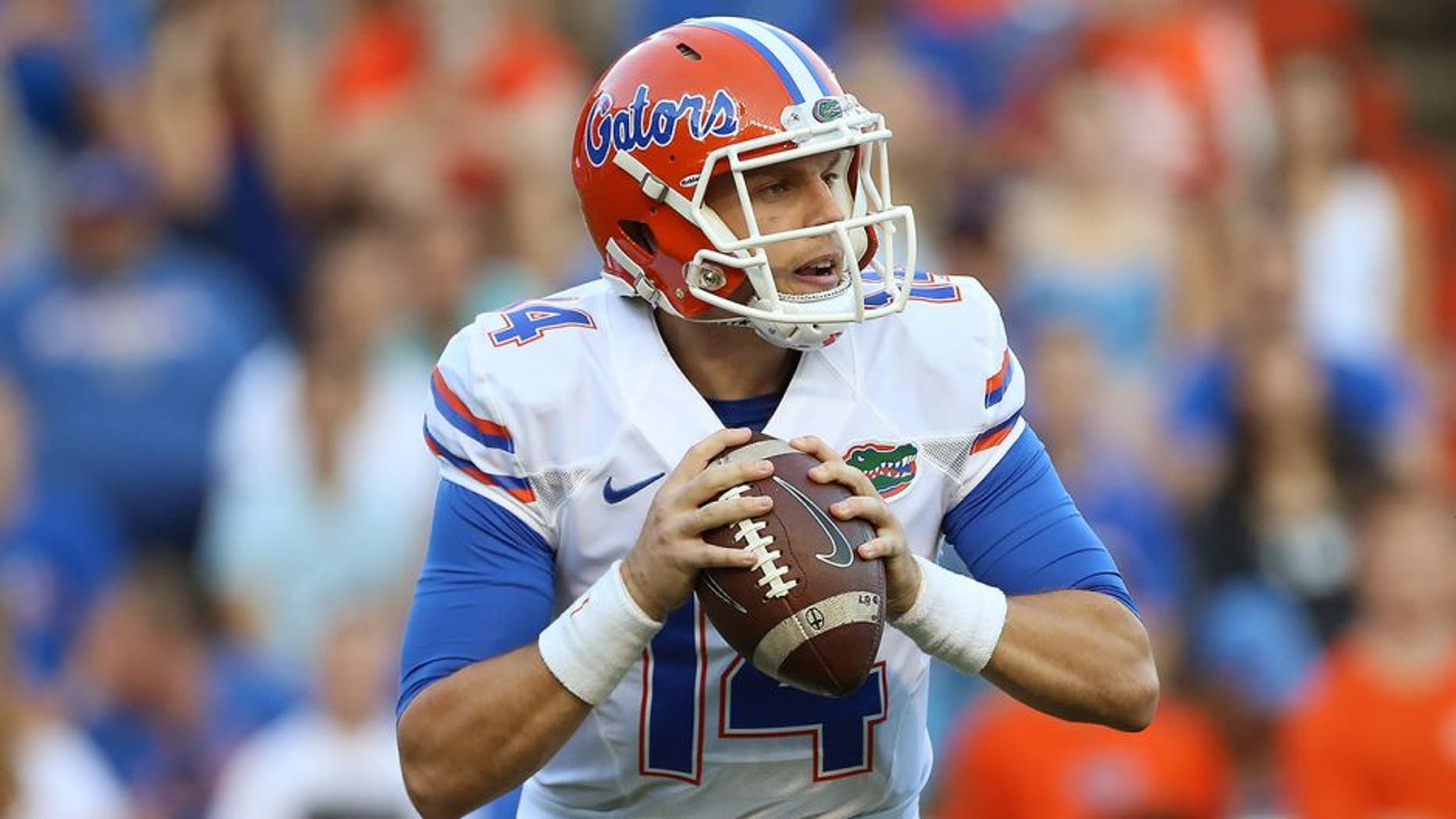 Apr 8, 2016; Gainesville, FL, USA; Florida Gators quarterback Luke Del Rio (14) looks to pass in the first quarter of the Orange and Blue at Ben Hill Griffin Stadium. Mandatory Credit: Logan Bowles-USA TODAY Sports