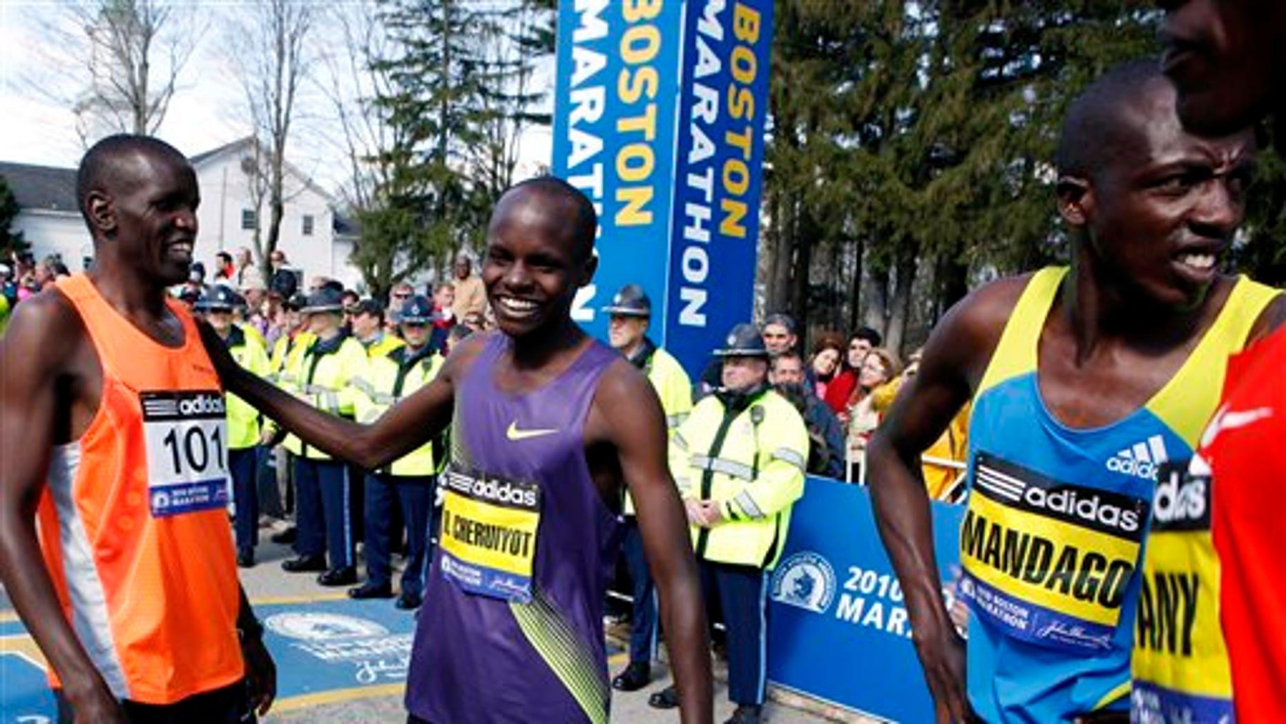 April 19: Kenyan runners, from left, James Koskei, Robert Cheruiyot, and David Mandago, wait for the start of the 114th running of the Boston Marathon in Hopkinton, Mass. Cheruiyot won the race.