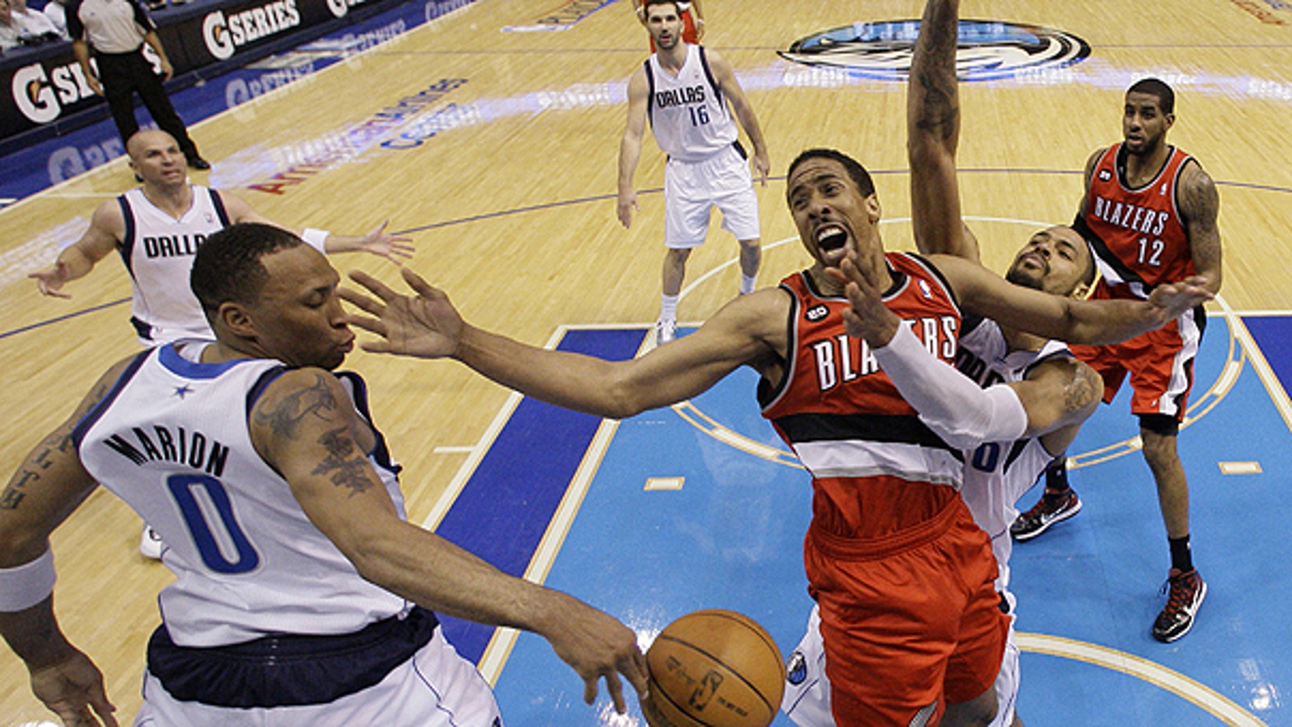 April 19: Portland Trail Blazers' Andre Miller, center, loses control of the ball going to the basket against Dallas Mavericks' Shawn Marion (0) and Tyson Chandler, right, in the second half of an NBA basketball game in Dallas.