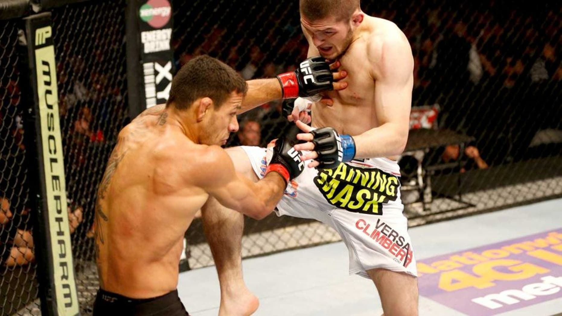 ORLANDO, FL - APRIL 19: (R-L) Khabib Nurmagomedov lands a flying knee against Rafael dos Anjos in their lightweight bout during the FOX UFC Saturday event at the Amway Center on April 19, 2014 in Orlando, Florida. (Photo by Josh Hedges/Zuffa LLC/Zuffa LLC via Getty Images)