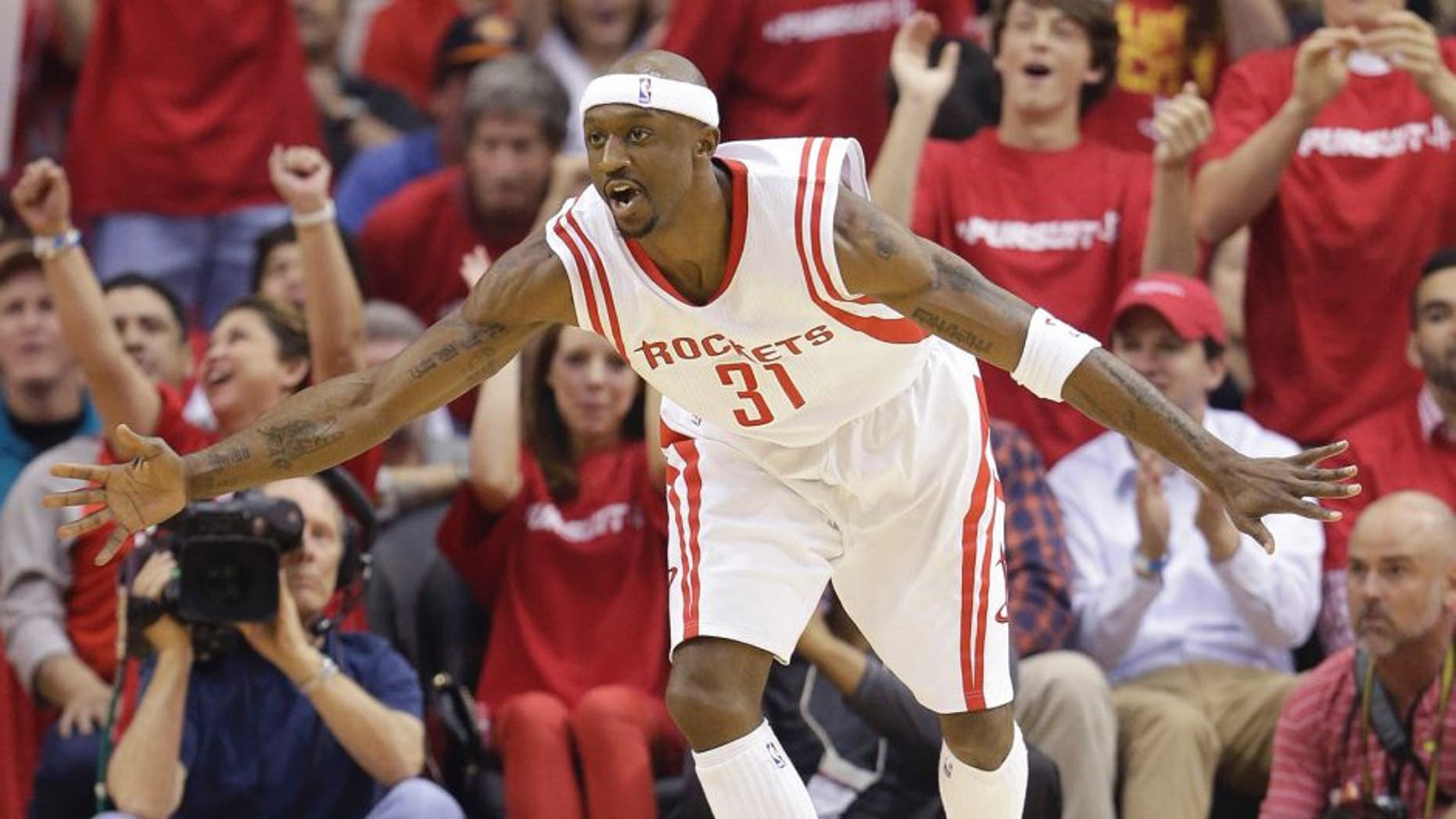 Houston Rockets' Jason Terry (31) celebrates a score against the Dallas Mavericks during the first quarter of game 1 in the first round of the NBA basketball playoffs Saturday, April 18, 2015, in Houston. (AP Photo/David J. Phillip)