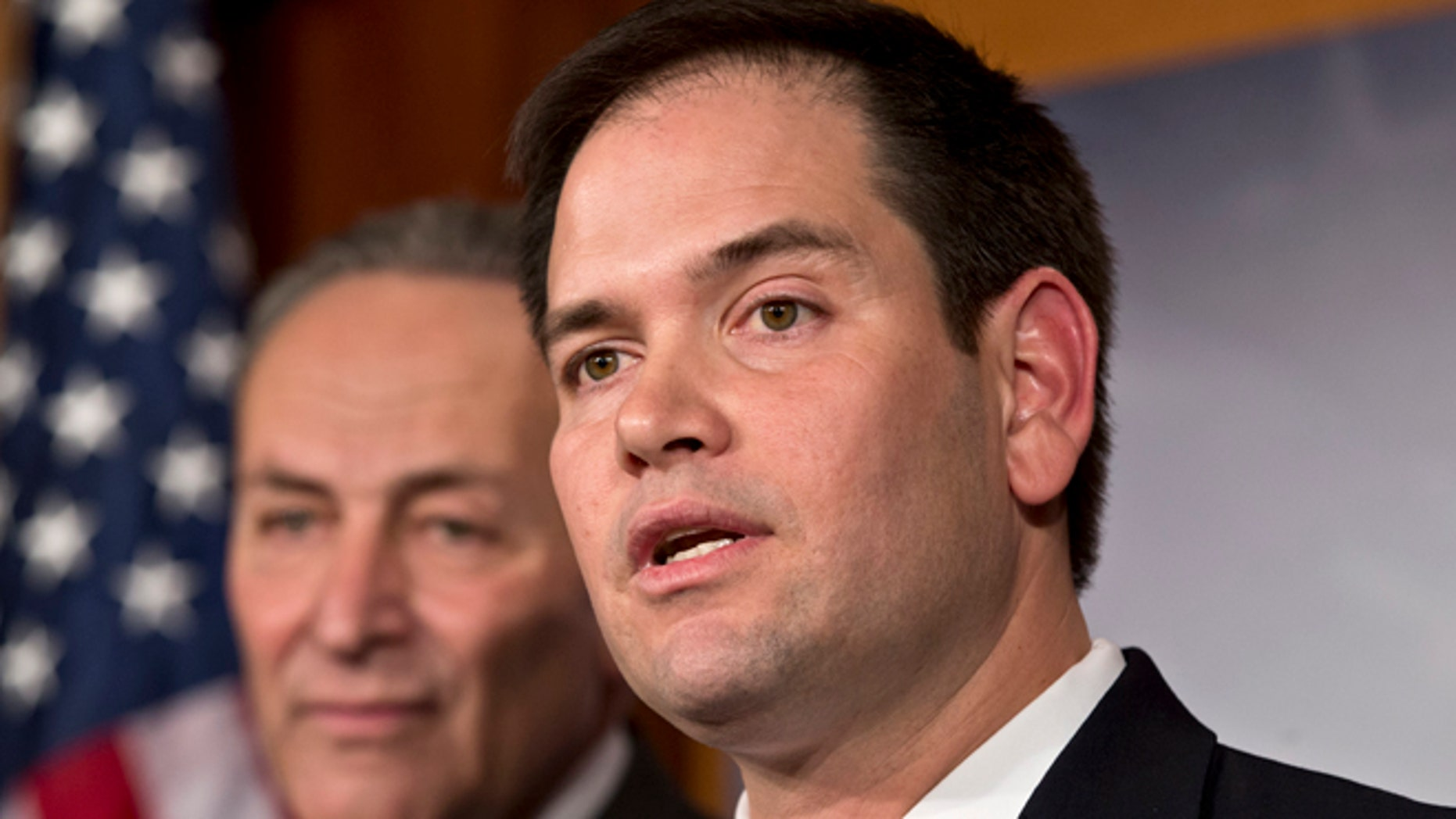 FILE - In this Jan. 28, 2013, photo, Sen. Marco Rubio, R-Fla., right, and Sen. Charles Schumer, D-N.Y., left, join a bipartisan group of leading senators to announce that they have reached agreement on the principles of sweeping legislation to rewrite the nation's immigration laws, during a news conference at the Capitol in Washington. Republicans face a delicate balancing act as they embrace immigration reform _ and no one is more symbolic of the potential risks and rewards than Rubio.  (AP Photo/J. Scott Applewhite)